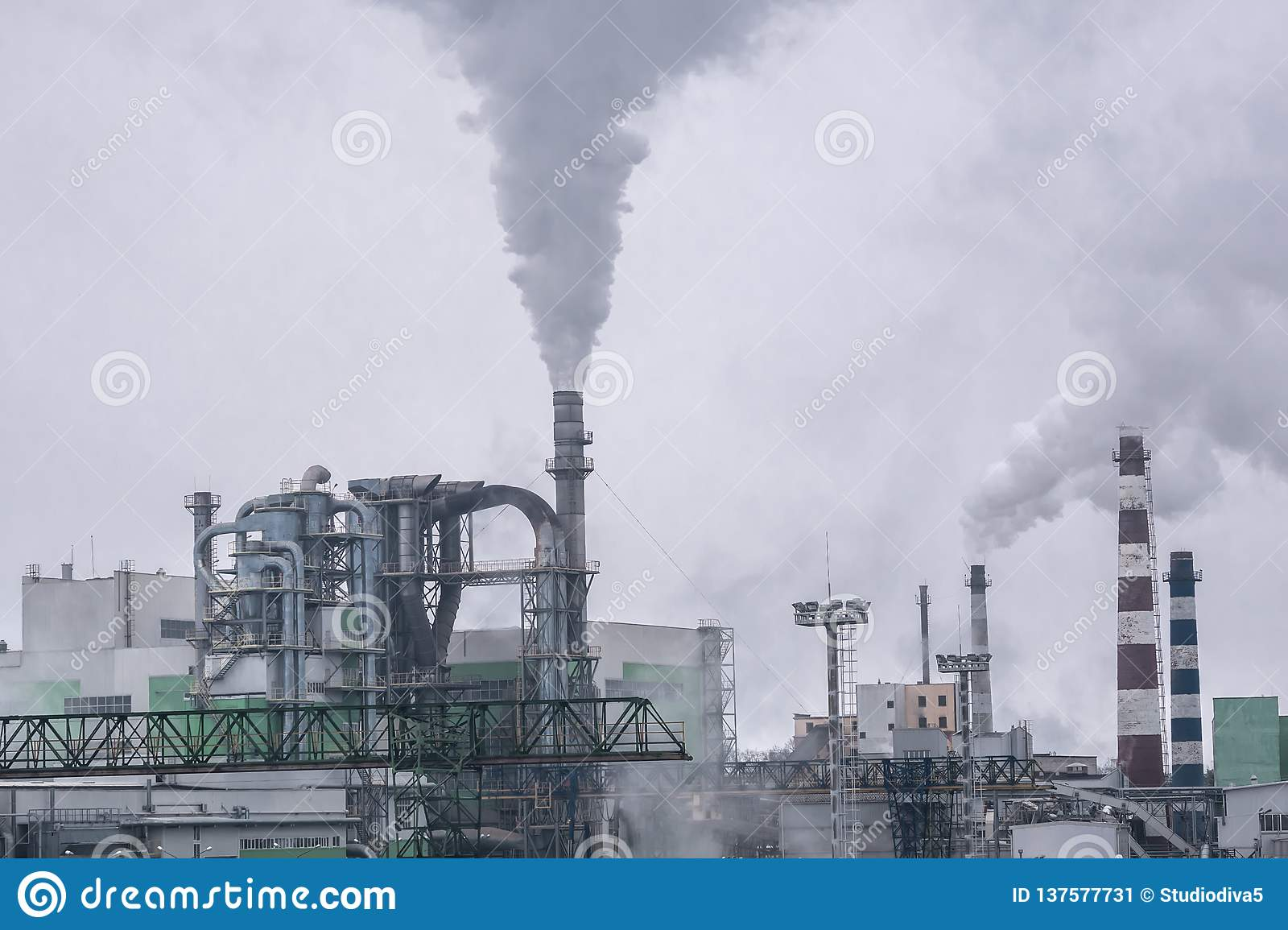 The factory releases a lot of smoke and smog into the sky