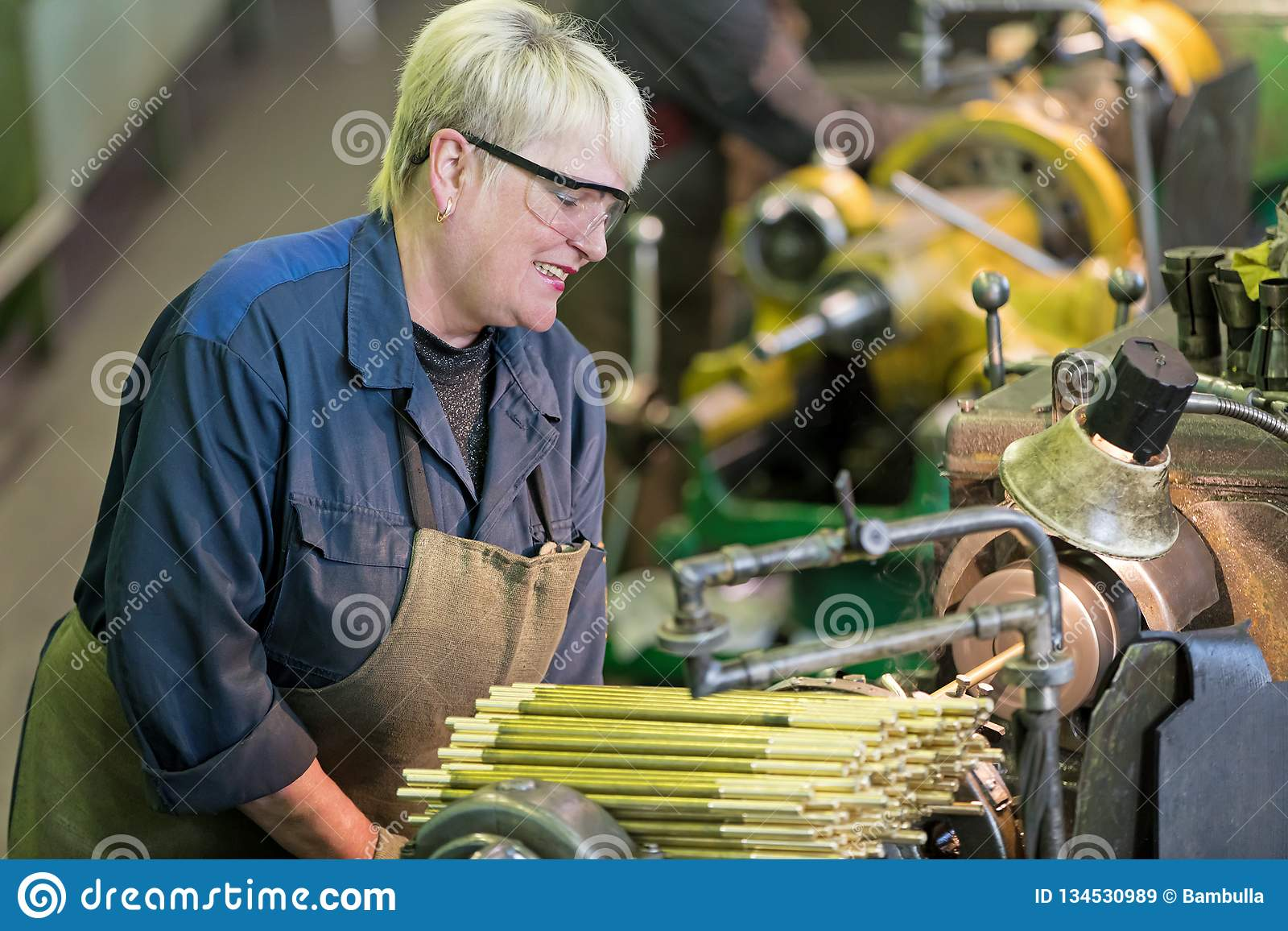 Factory Woman Turner Working On Workshop Lathe Machine Stock Image