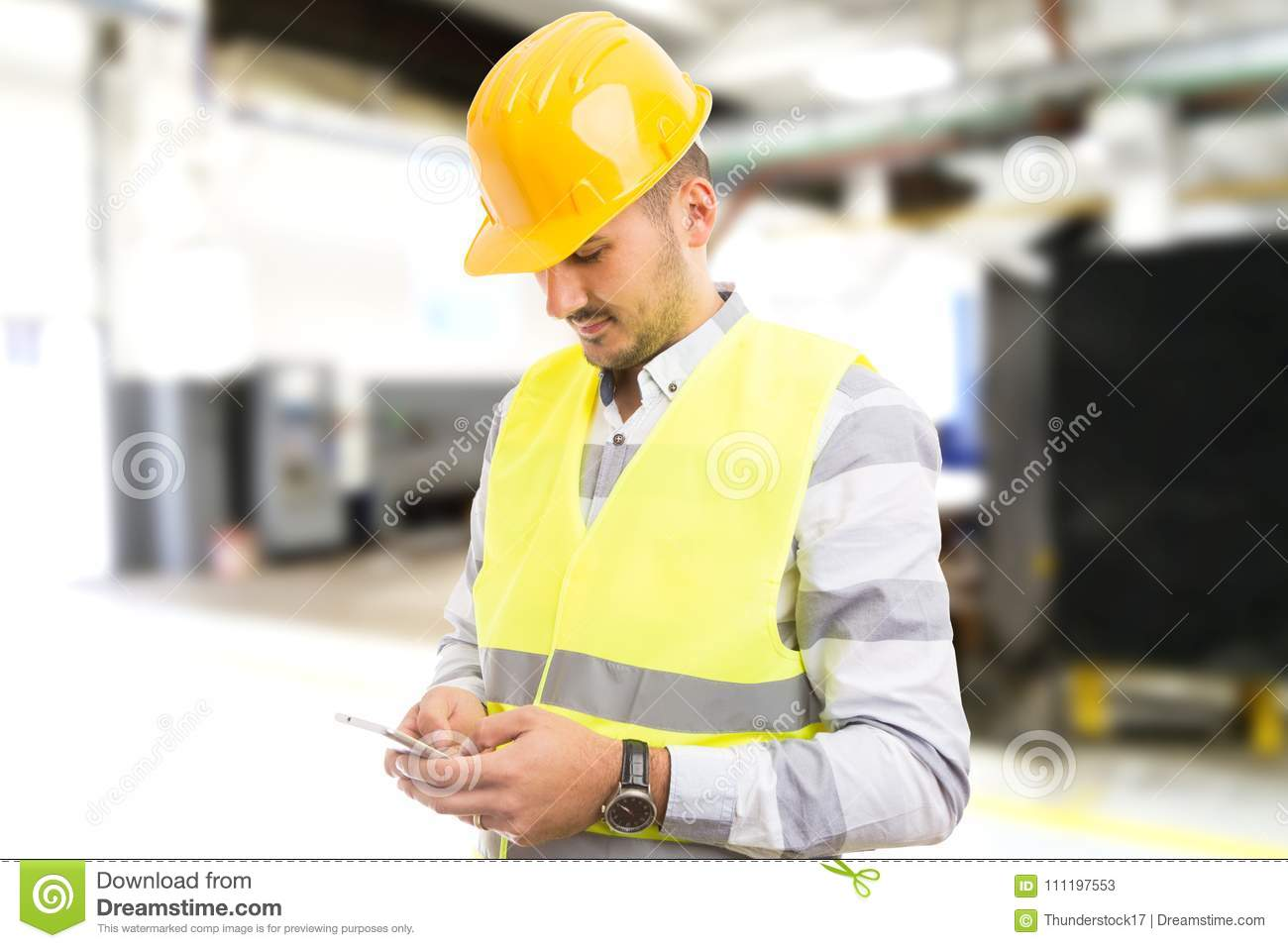 Factory worker employee chatting browsing texting on smartphone