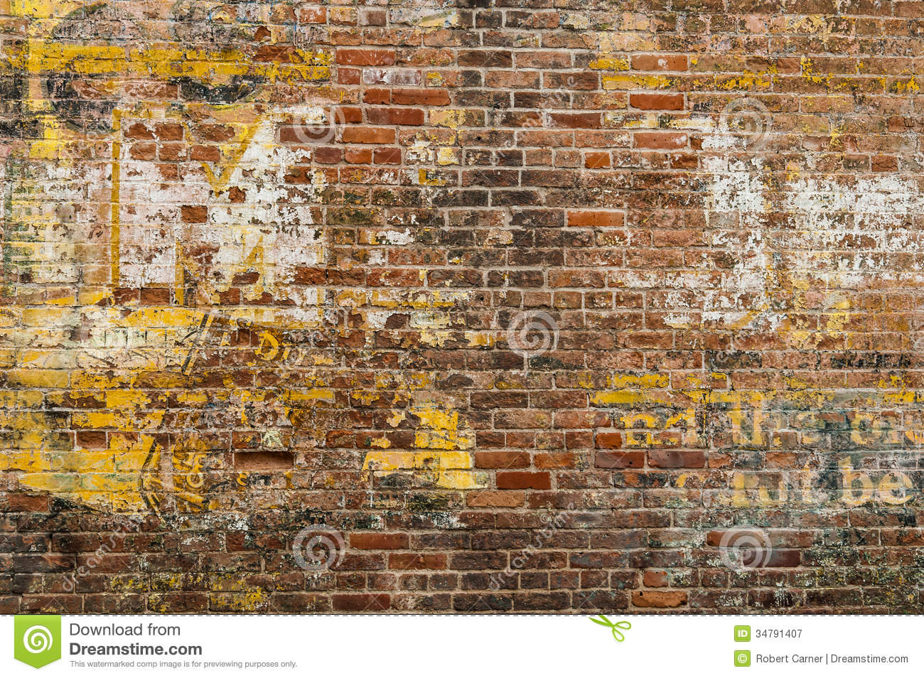 faded advertisement on a brick wall royalty free stock