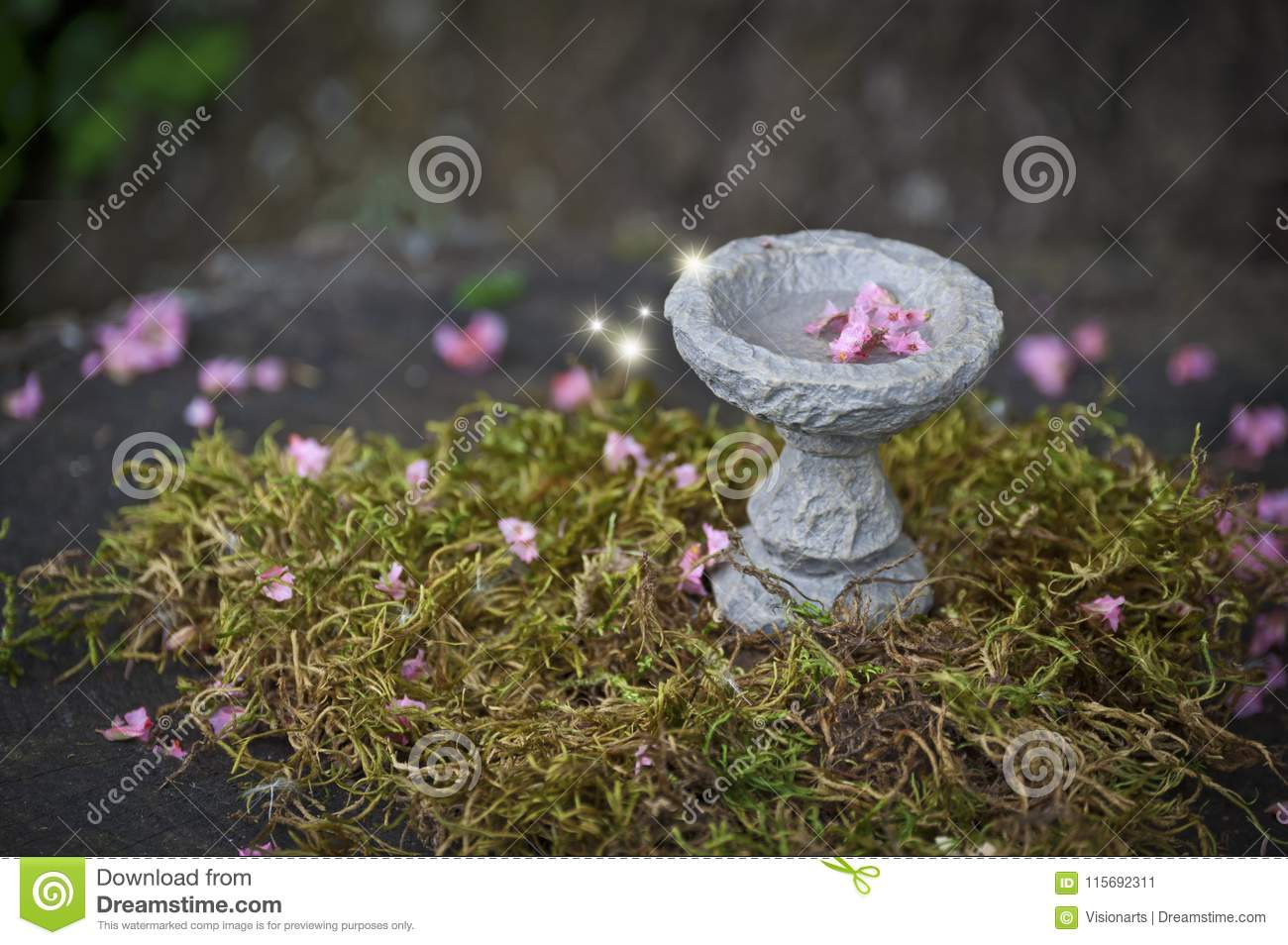Fairy bird bath with pink flowers and glowing lights