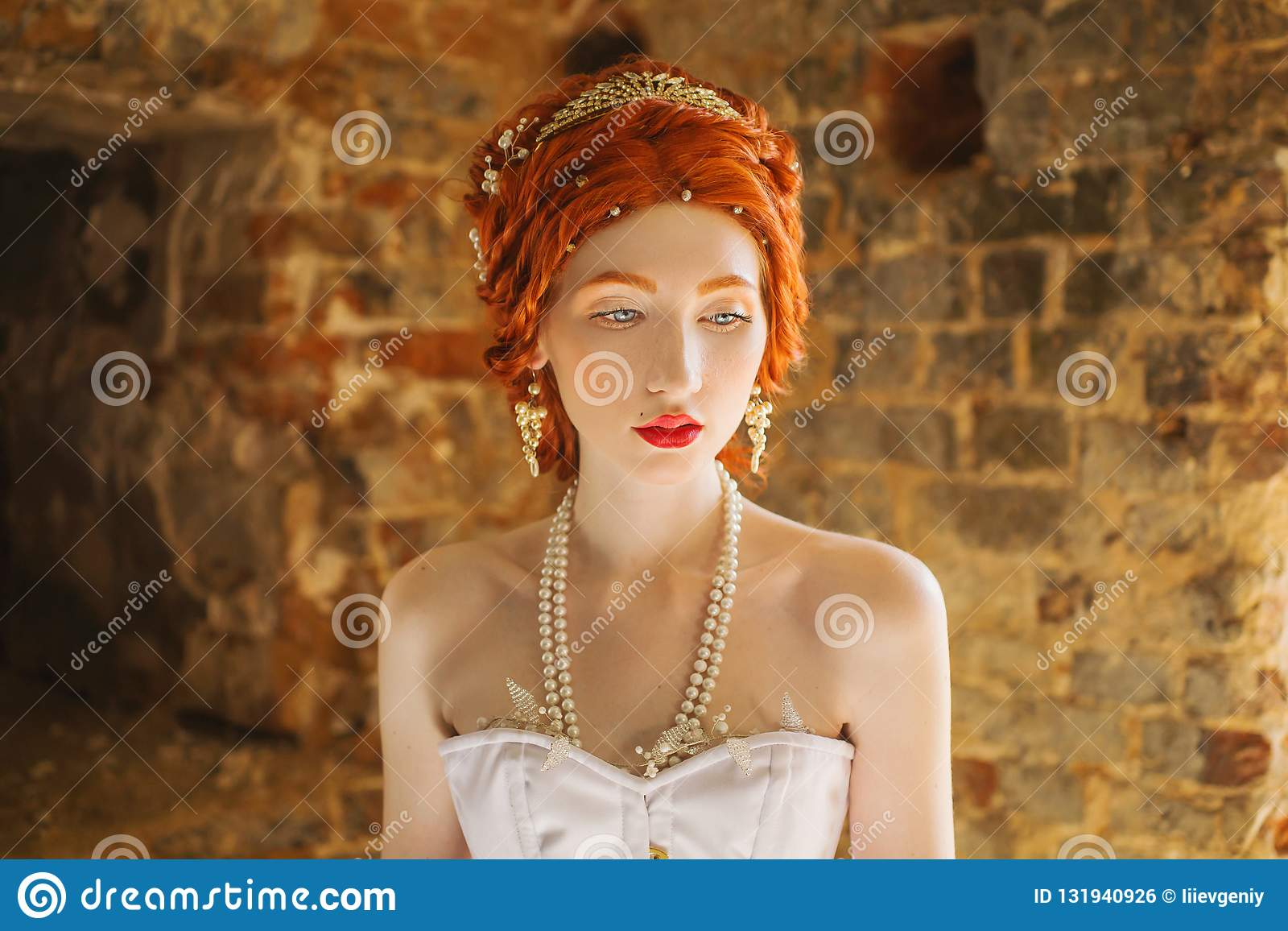 e2326903216 Fairy edwardian redhead princess with freckles in the old castle. Fabulous  rococo queen against backdrop of stone wall. Edwardian doll.