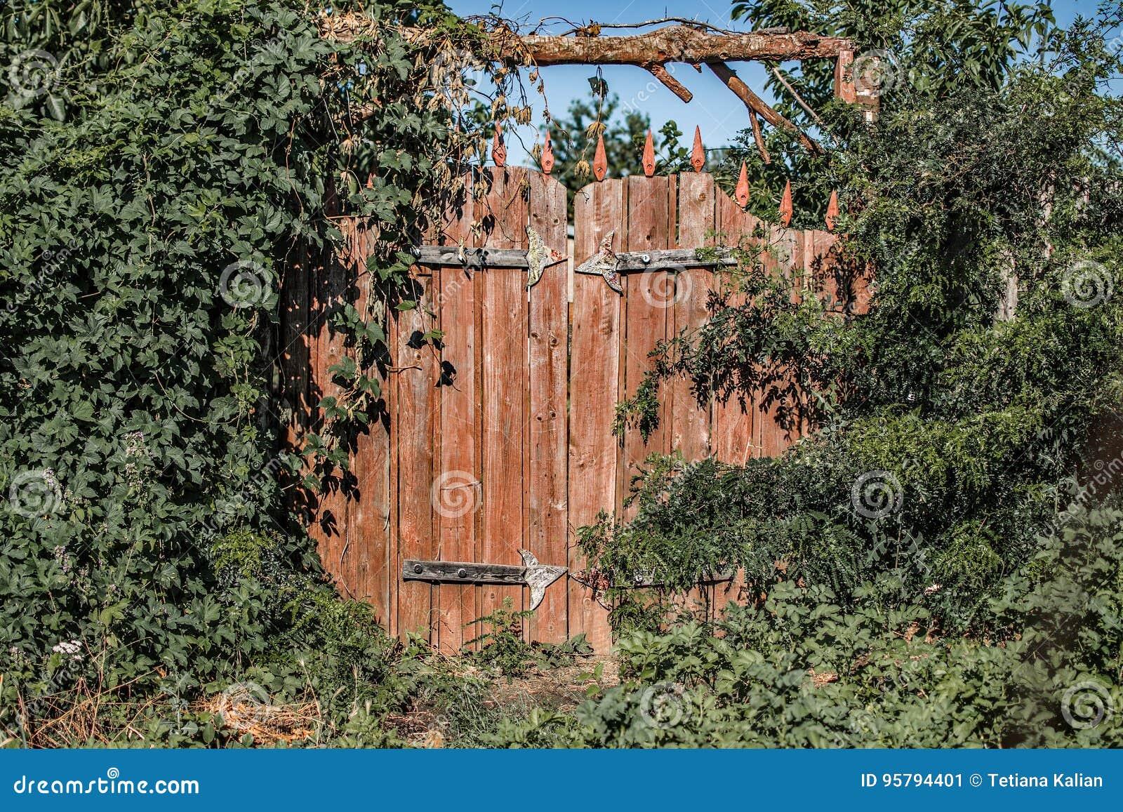 A Fairy Gate To The Secret Garden. Abandoned Overgrown Garden Stock ...