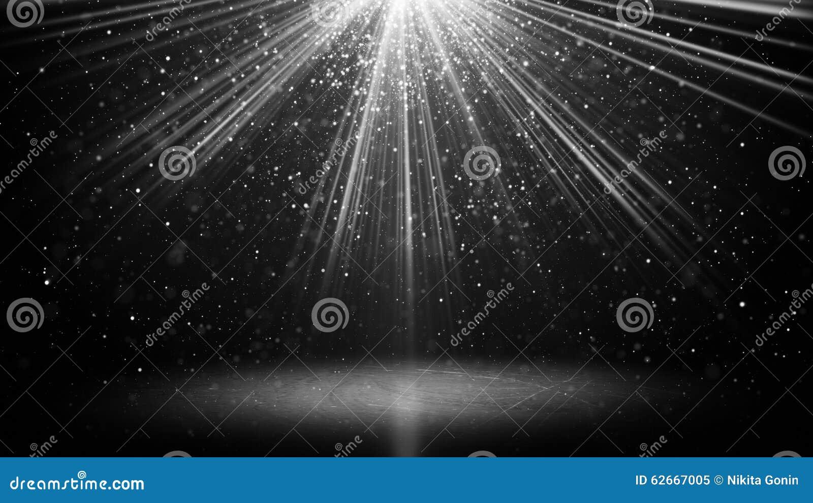 Faisceaux lumineux blancs et particules sur le fond noir d abstarct