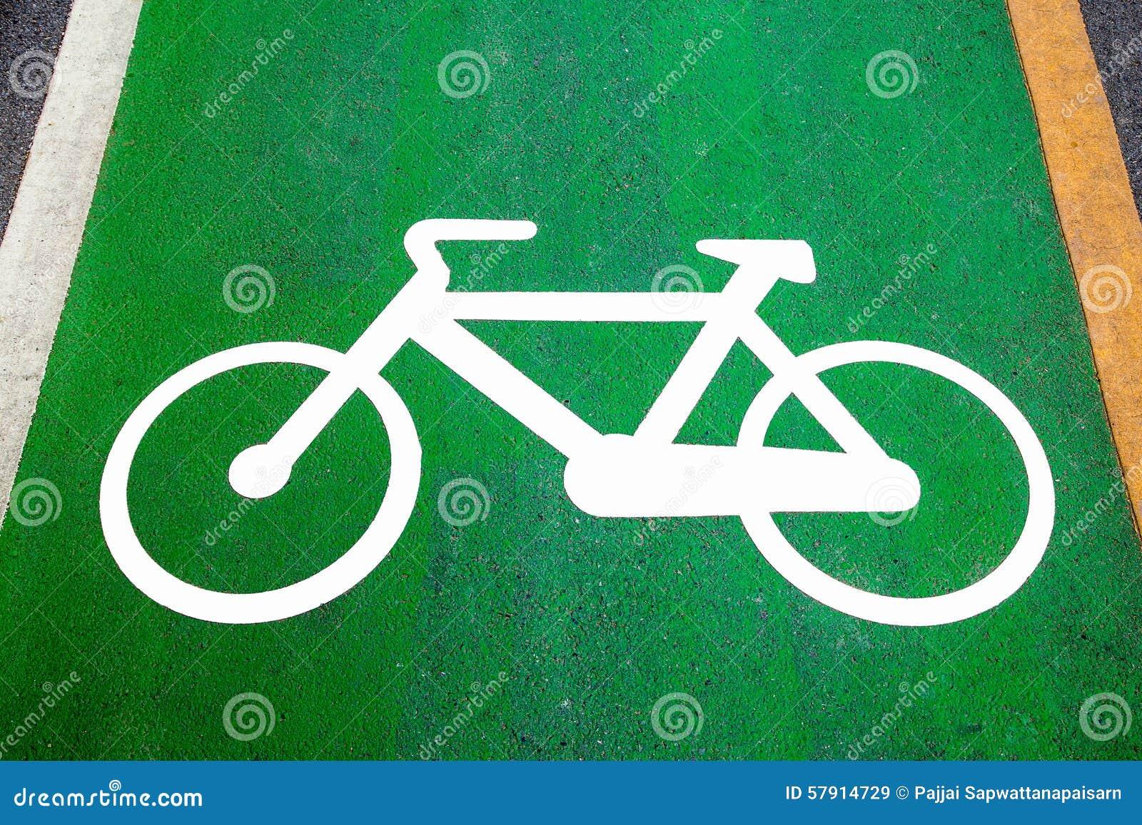 Faites du vélo les signes de ruelle peints sur une ruelle de vélo de vert (ruelle de vélo, route