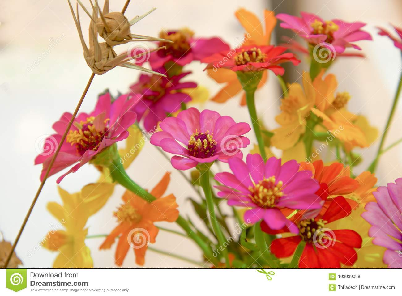 Fake Flowers Bouquet On Wallpaper Background Stock Photo