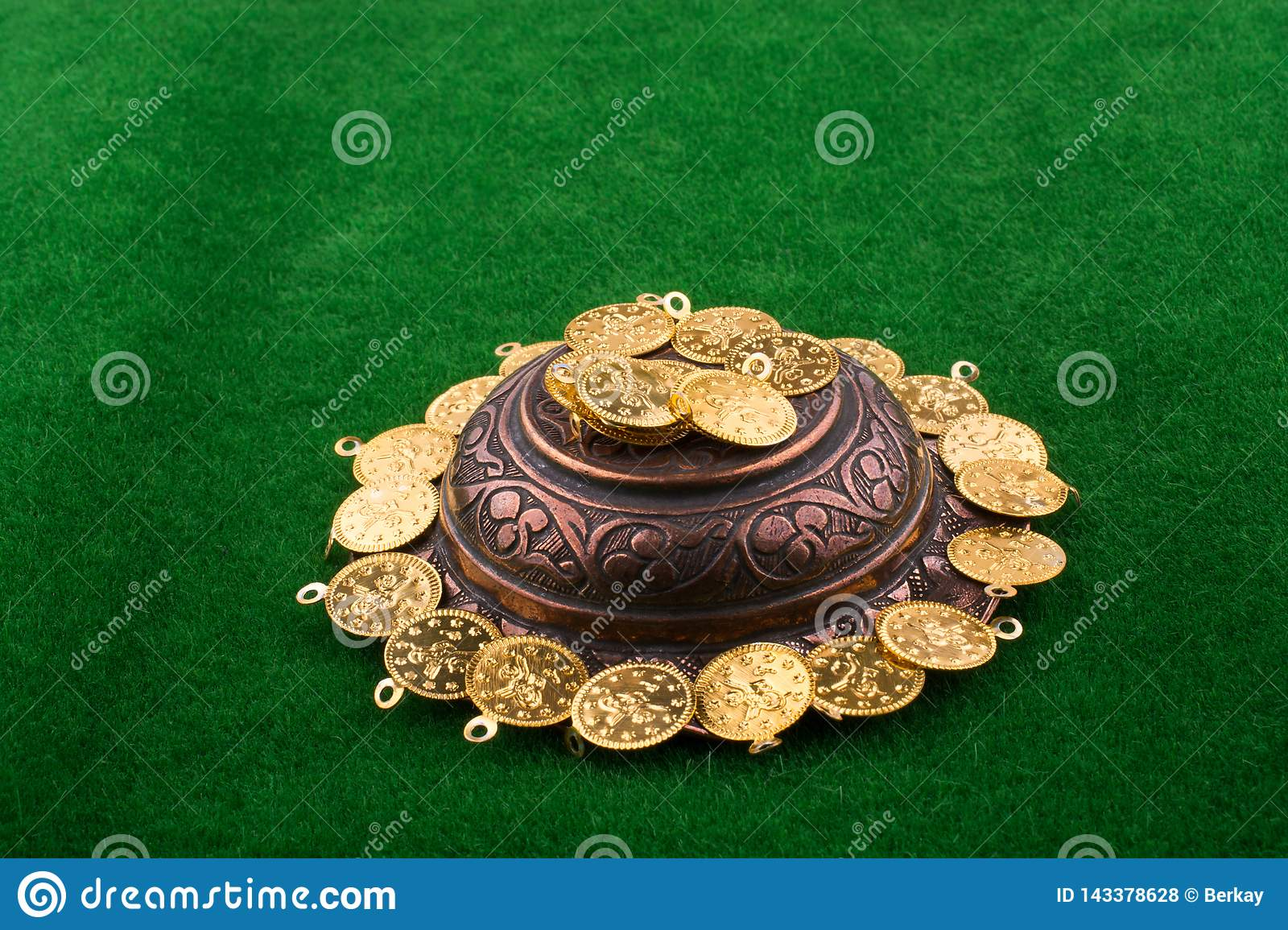 Fake gold coins around a metal  plate