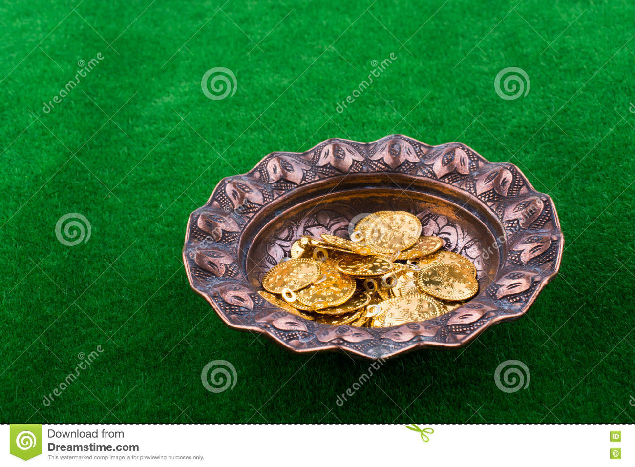 Fake gold coins in a metal plate