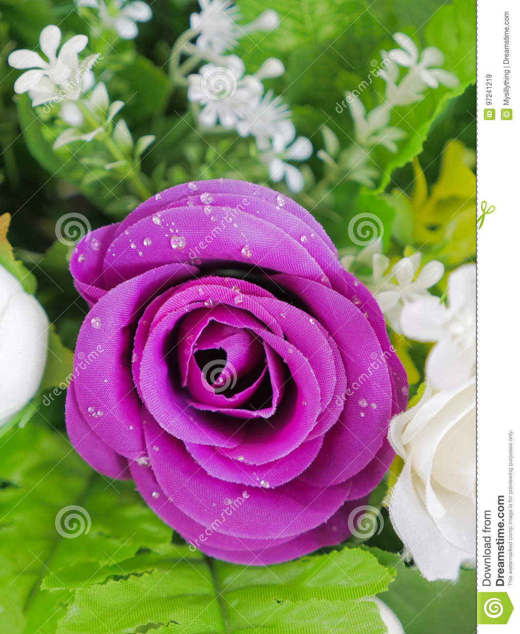 Fake purple rose flowers with artificial water drop stock image elegant and beautiful fake purple rose flowers with artificial water drop izmirmasajfo