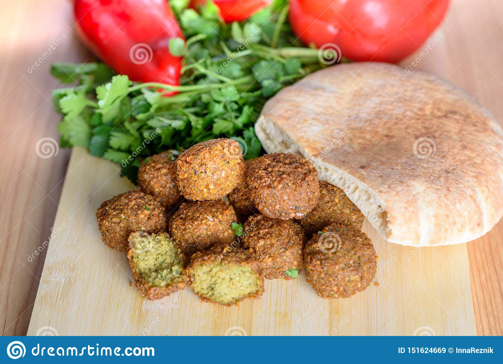 Falafel balls,sweet red pepper ,pita-arabian bread and green fresh parsley on wood rustic background.