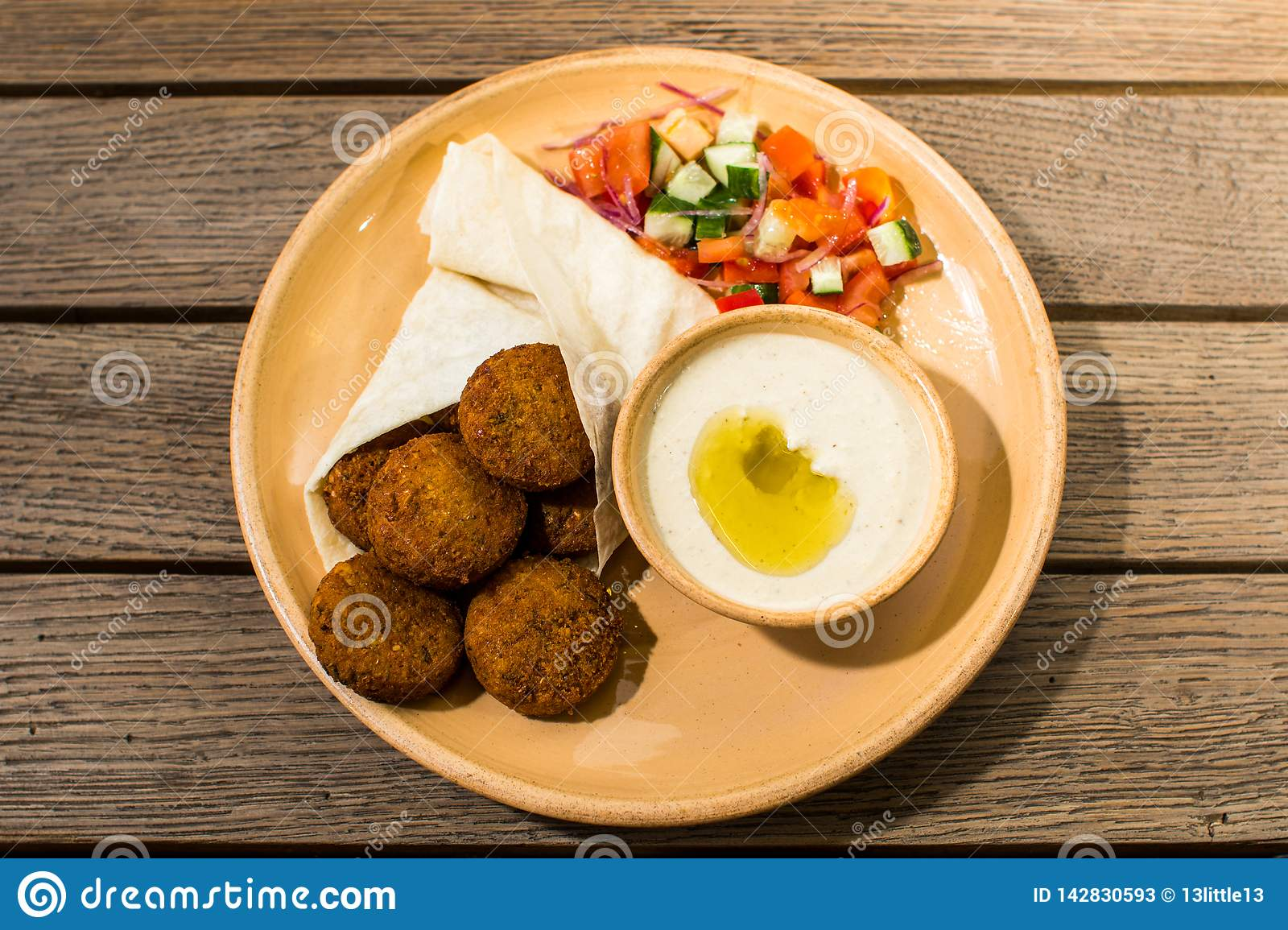 Falafel with salad and sauce