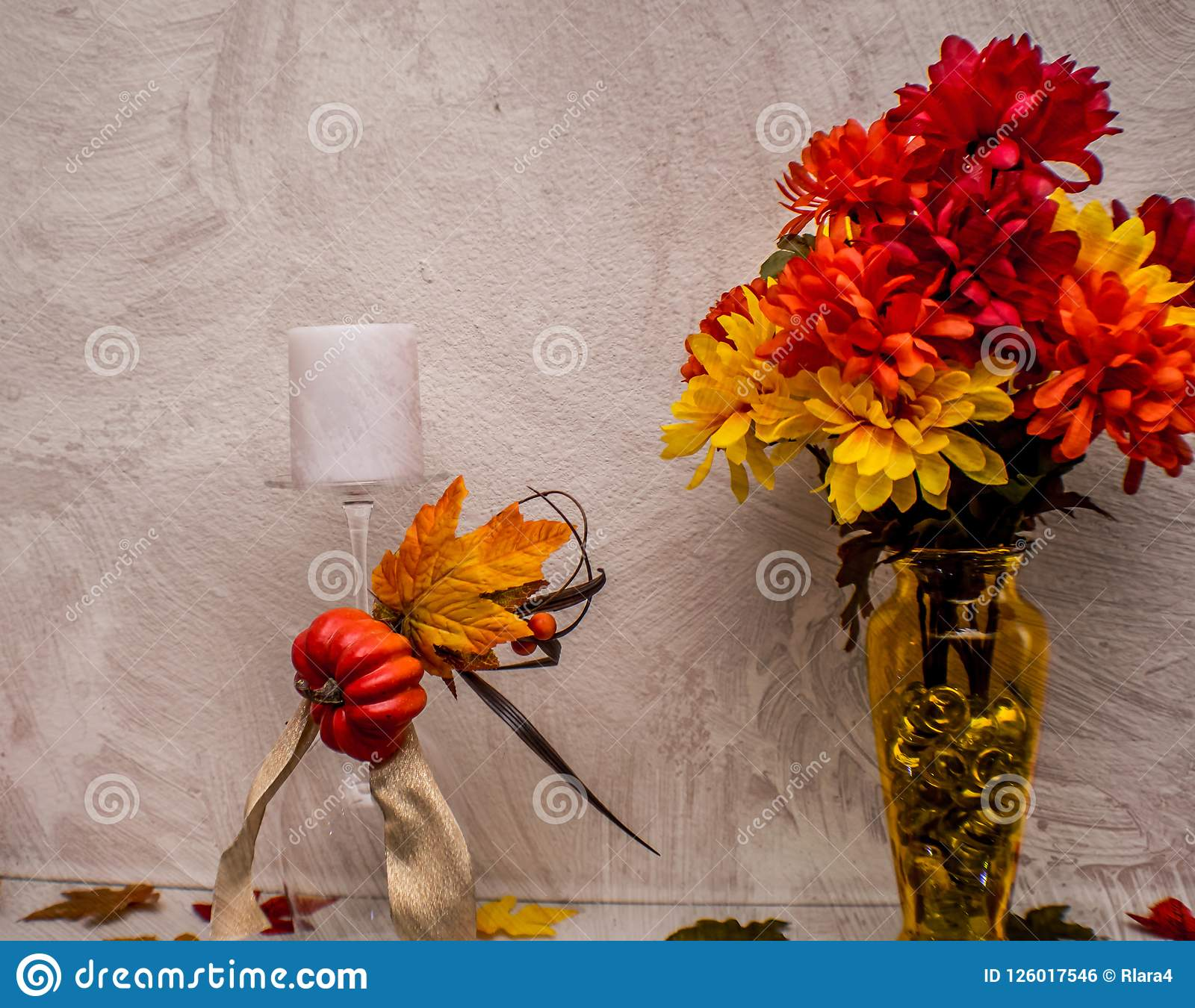 Fall decorflowers with texturedpainting overlay stock photo pretty bold colorful fall flowers and candle decor with a textured painting overlay mightylinksfo