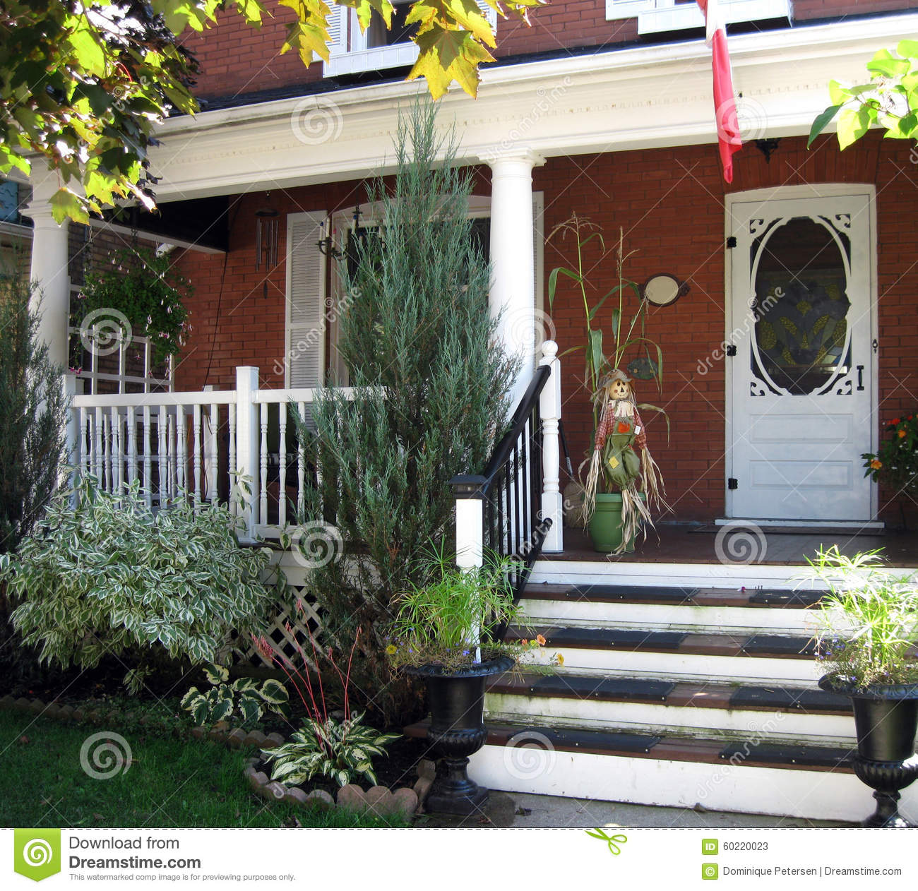 Front Porch Of Yellow House Stock Photo: Fall Display Stock Photo