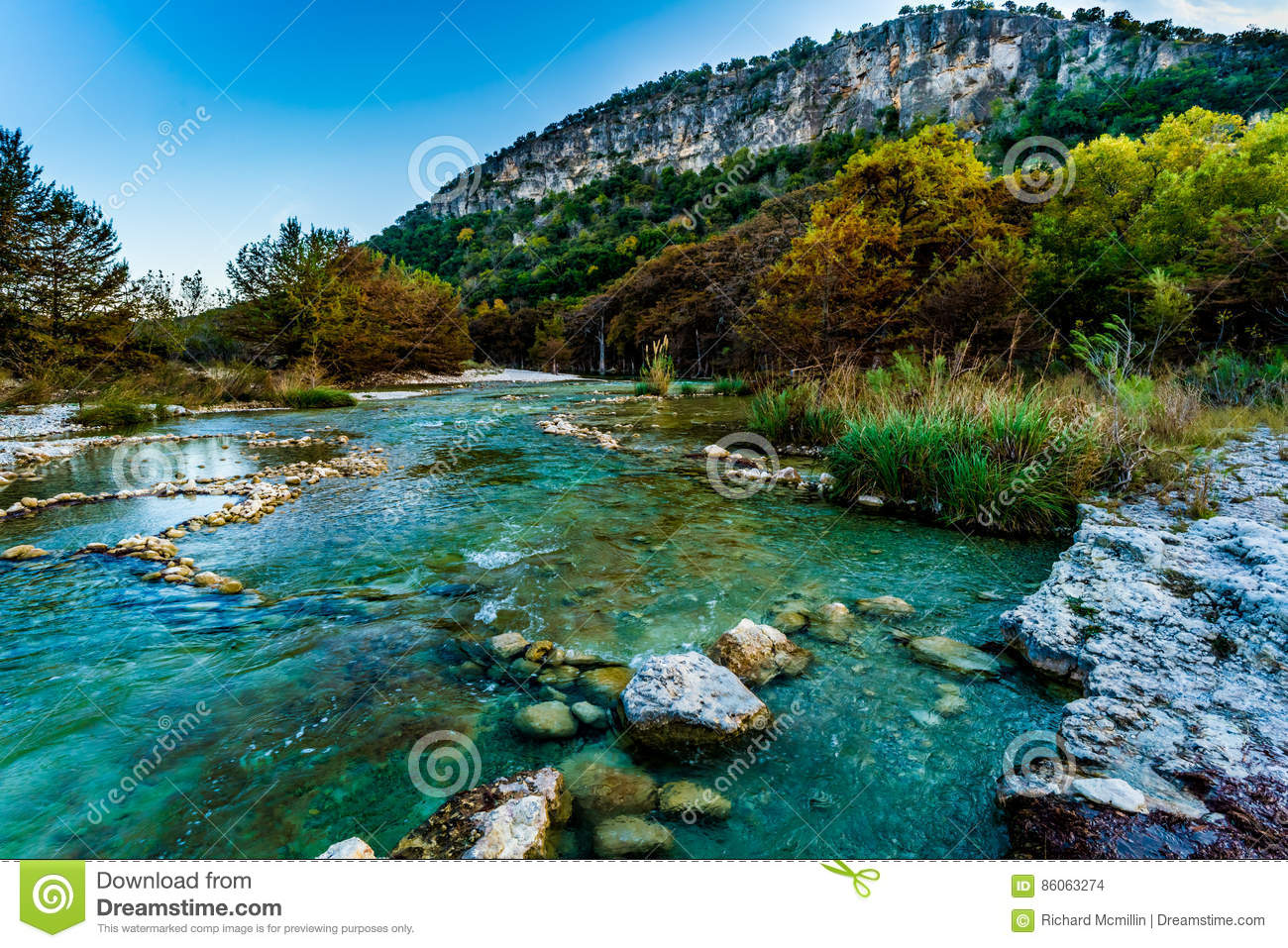 Fall Foliage On The Crystal Clear Frio River In Texas Stock Photo