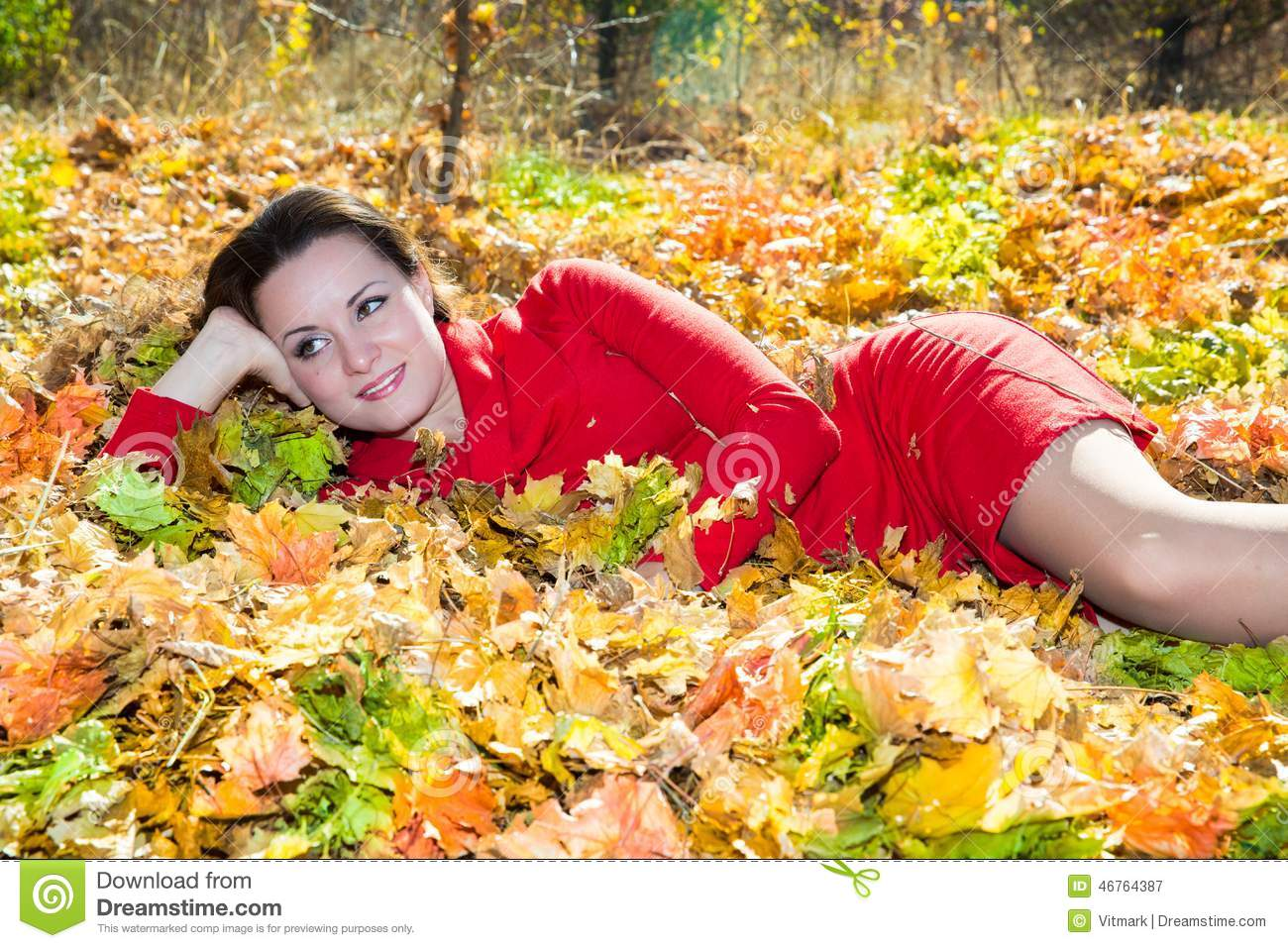 Fall. Portrait of beautiful young woman in autumn park
