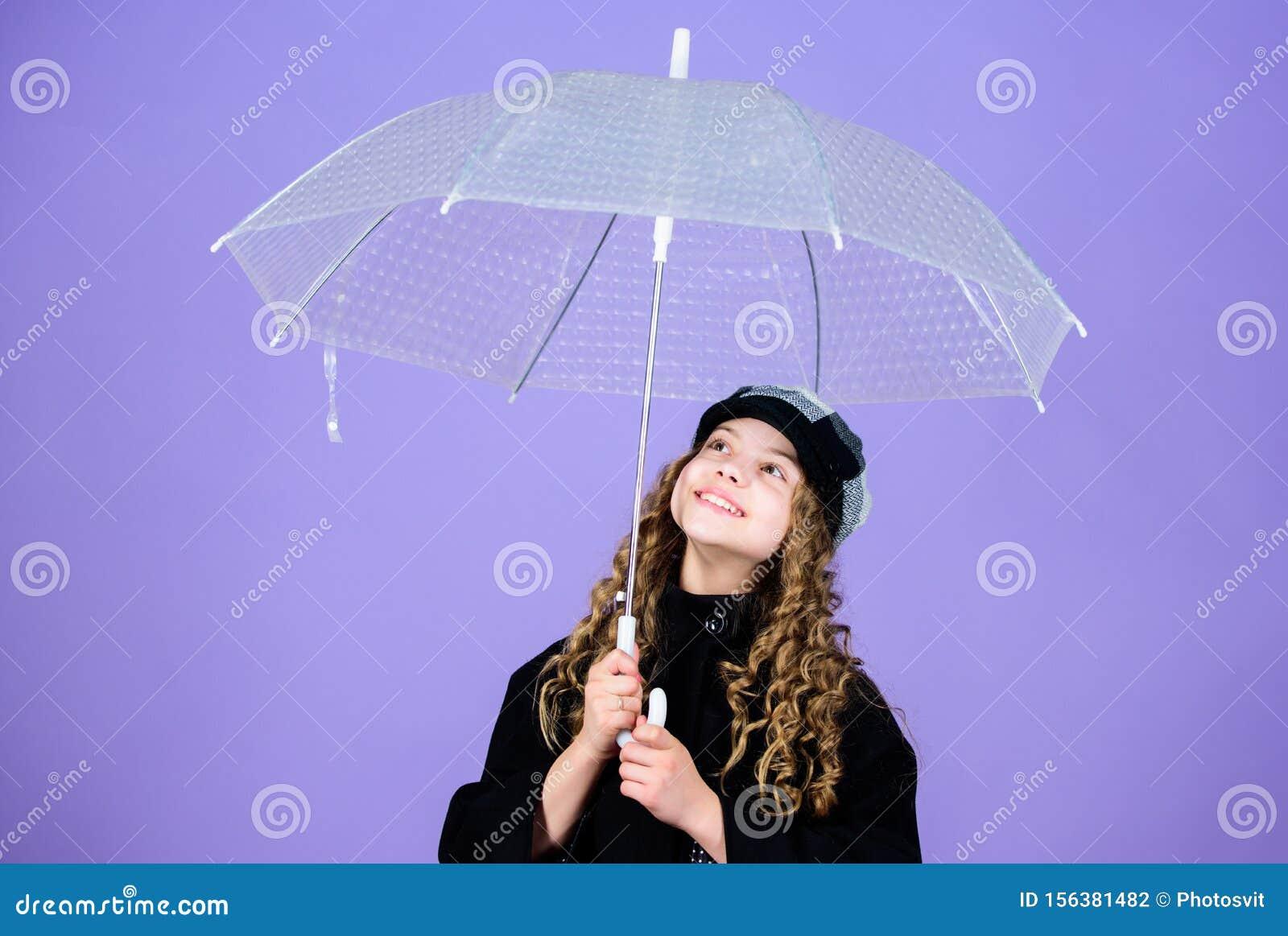 Fall season. Enjoy rain concept. Kids fashion trend. Love rainy days. Kid girl happy hold transparent umbrella. Enjoy