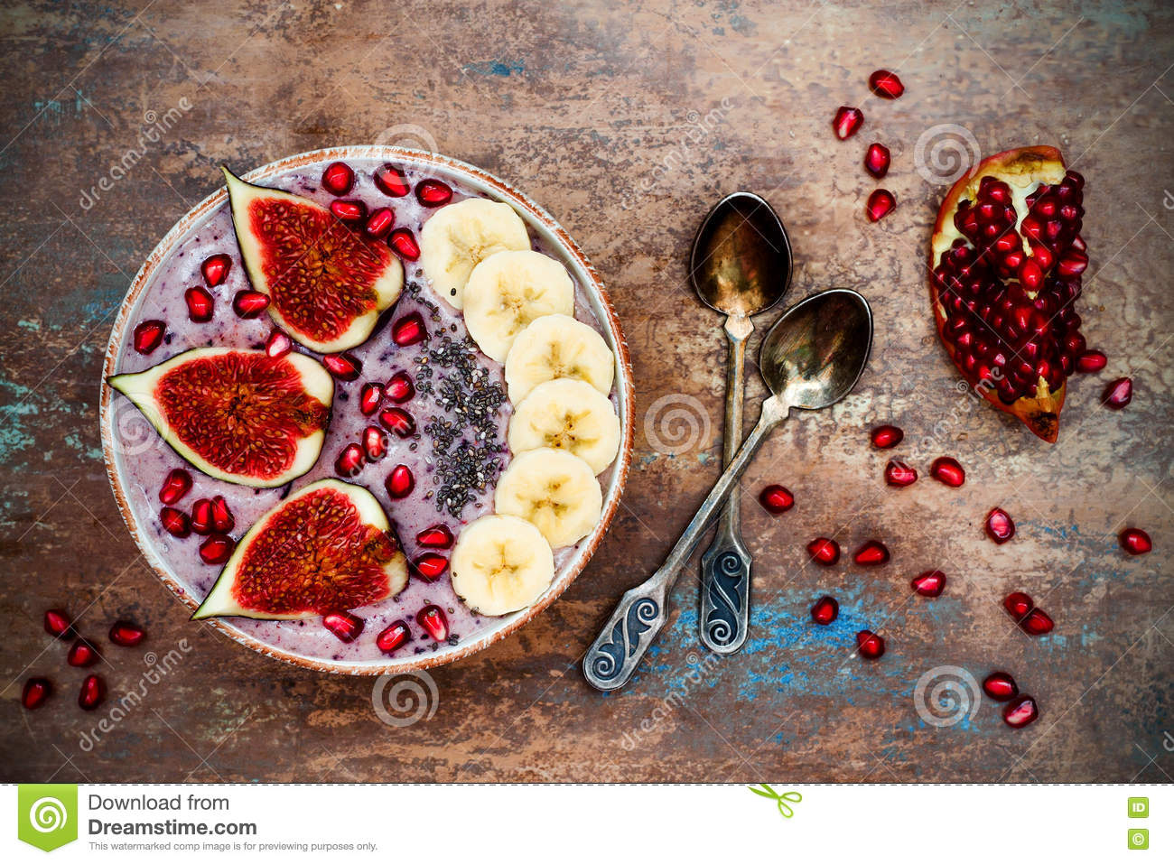 Fall and winter breakfast set acai superfoods smoothies bowl with chia seeds pomegranate - Autumn plowing time all set for winter ...