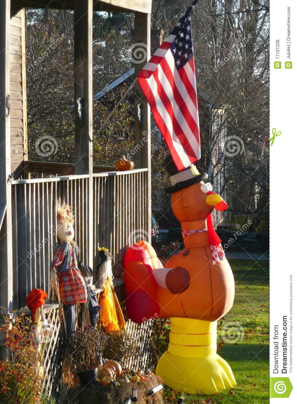 Fall yard with thanksgiving decorations and flag royalty