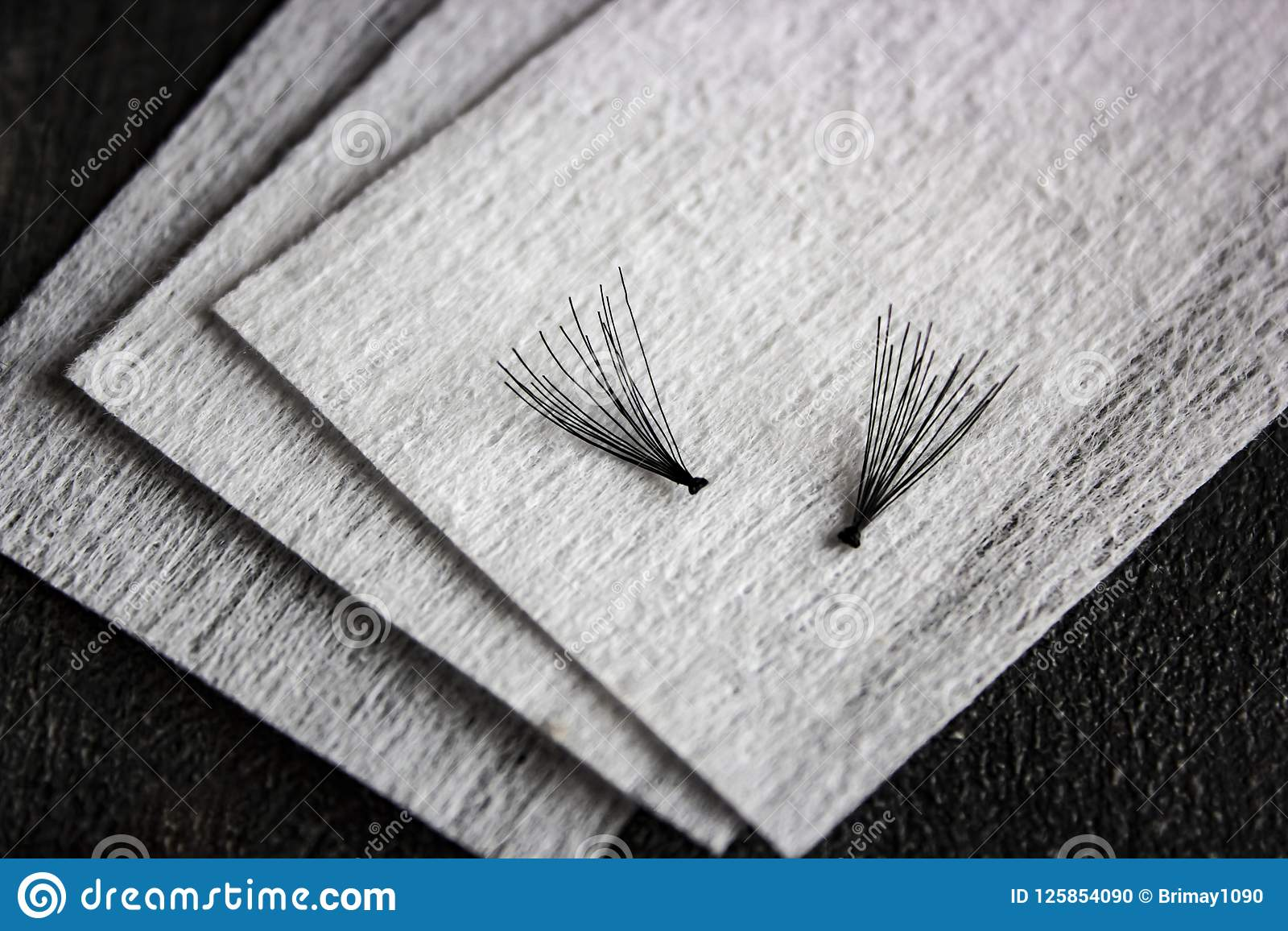 False black eyelashes on the clean cotton
