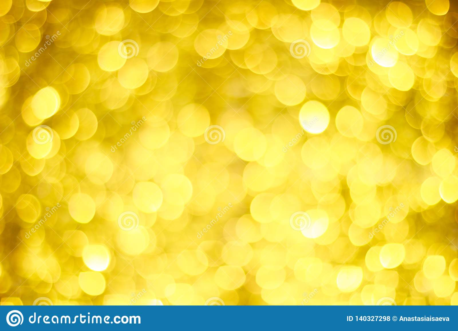 Falta de definición de oro de Bokeh Luces que brillan del oro Círculos de Bokeh