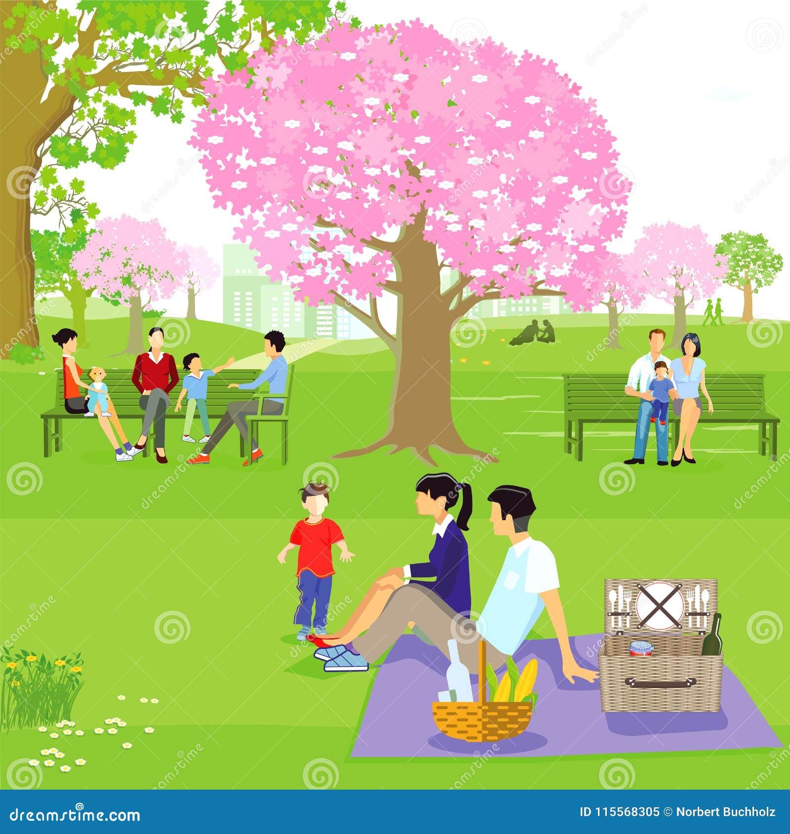 Famílias sentadas no parque da mola