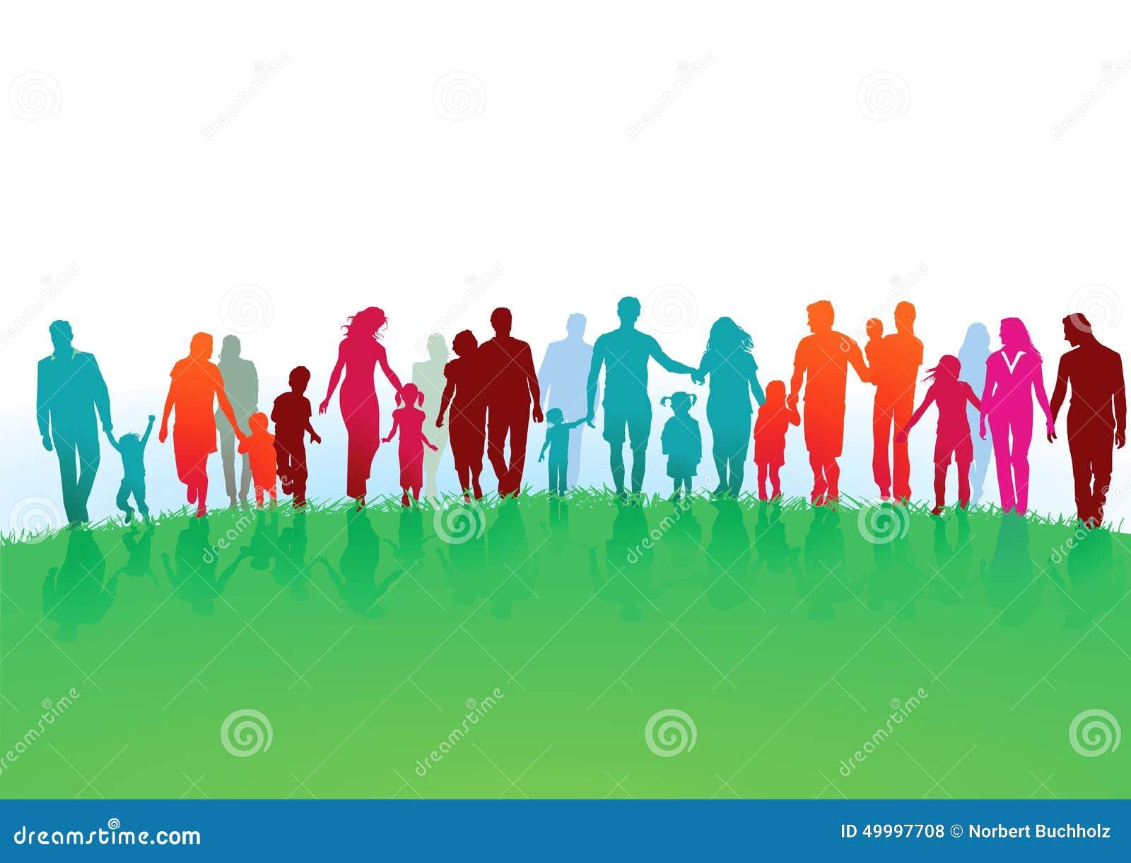 Families walking in green field