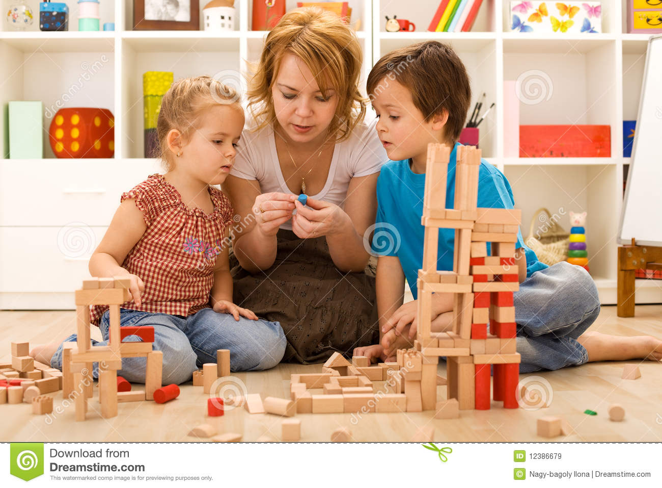 Family activities in the kids room - woman and children sitting on the ...