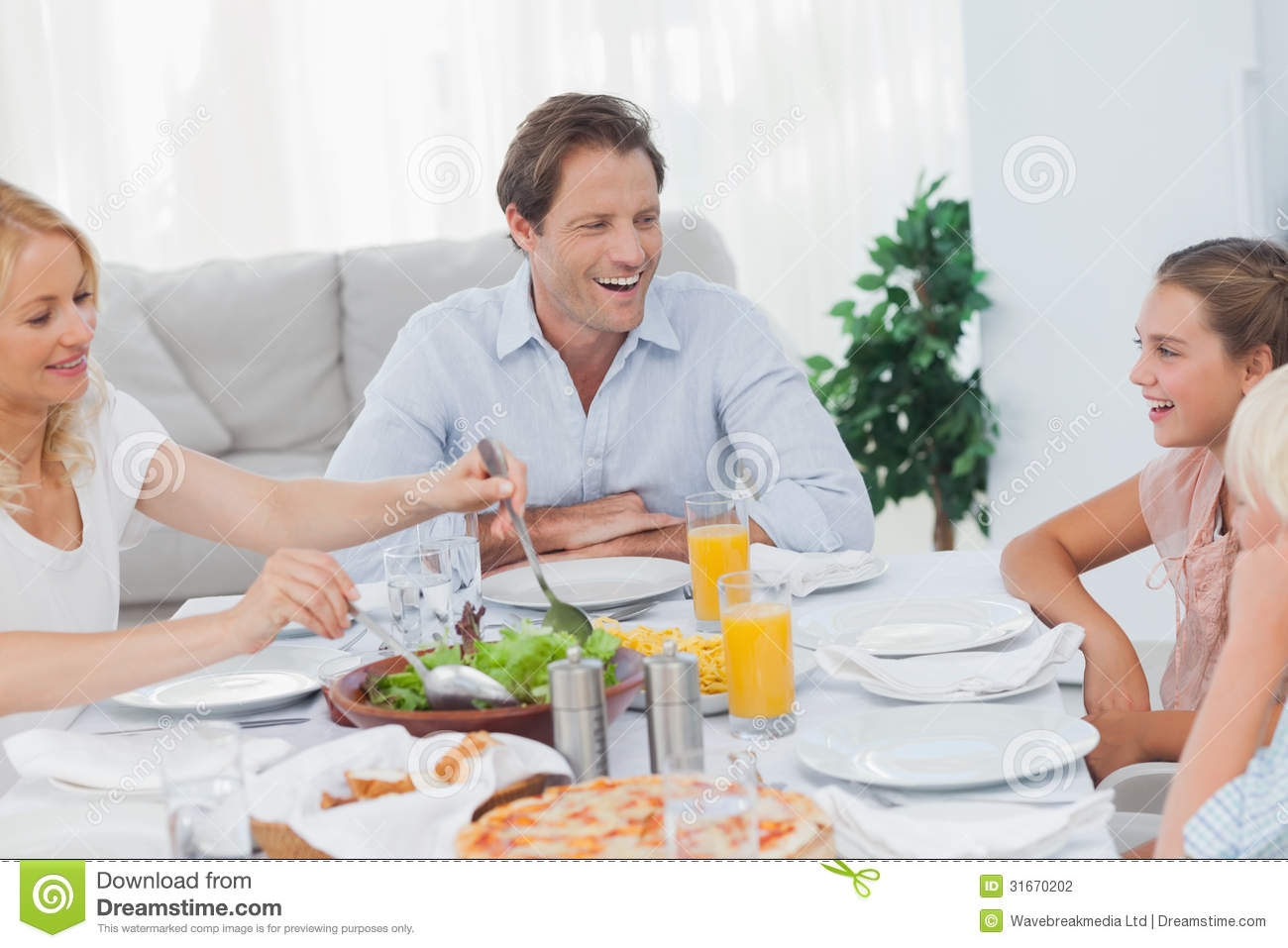 Family Around The Dinner Table Stock Photography Image  : family around dinner table smiling 31670202 from www.dreamstime.com size 1300 x 957 jpeg 111kB