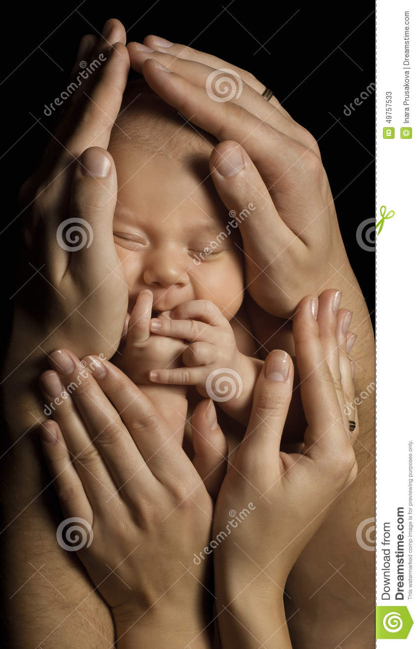 Family and Baby. New Born Kid in Parents Hands. Child Birth and Care Concept. Newborn Sleeping