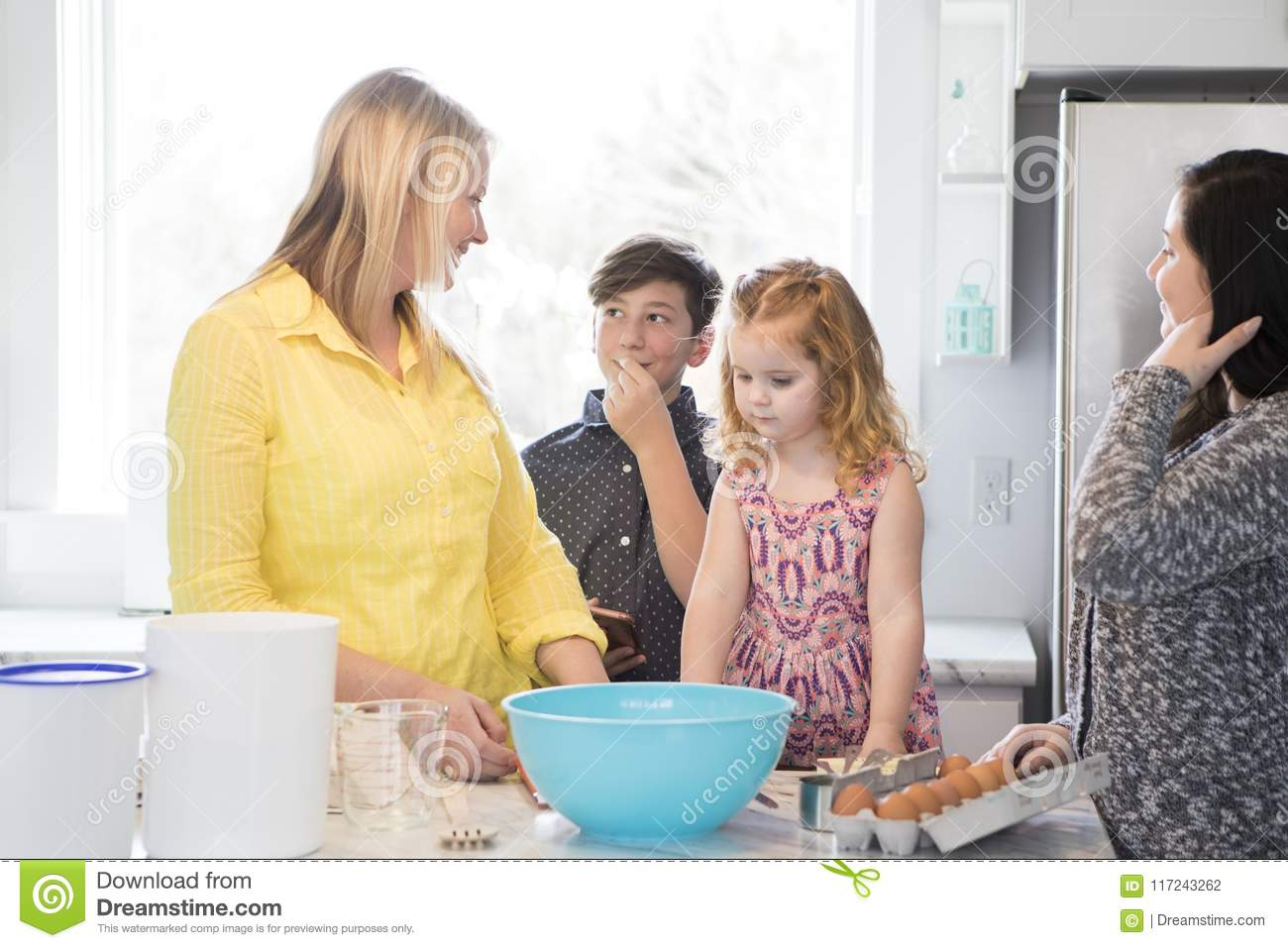 Family baking together in a modern kitchen.