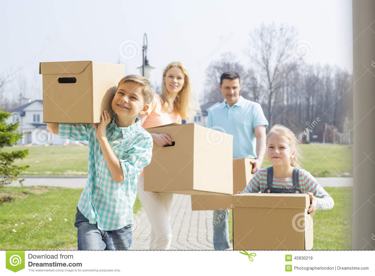 Siblings with cardboard box stock photography When is the best time to move house