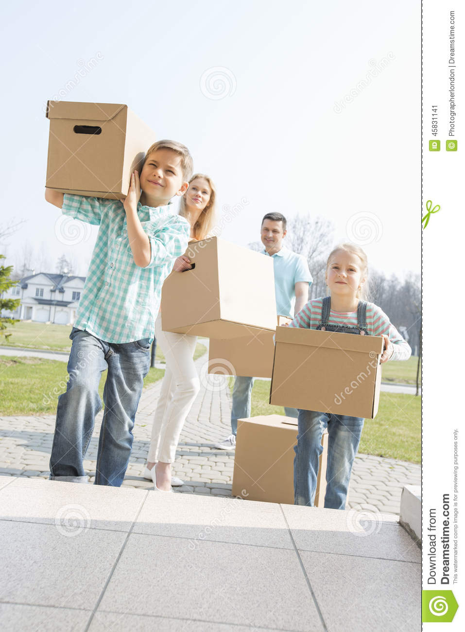 family carrying cardboard boxes while entering new house stock image image of ethnicity 12. Black Bedroom Furniture Sets. Home Design Ideas