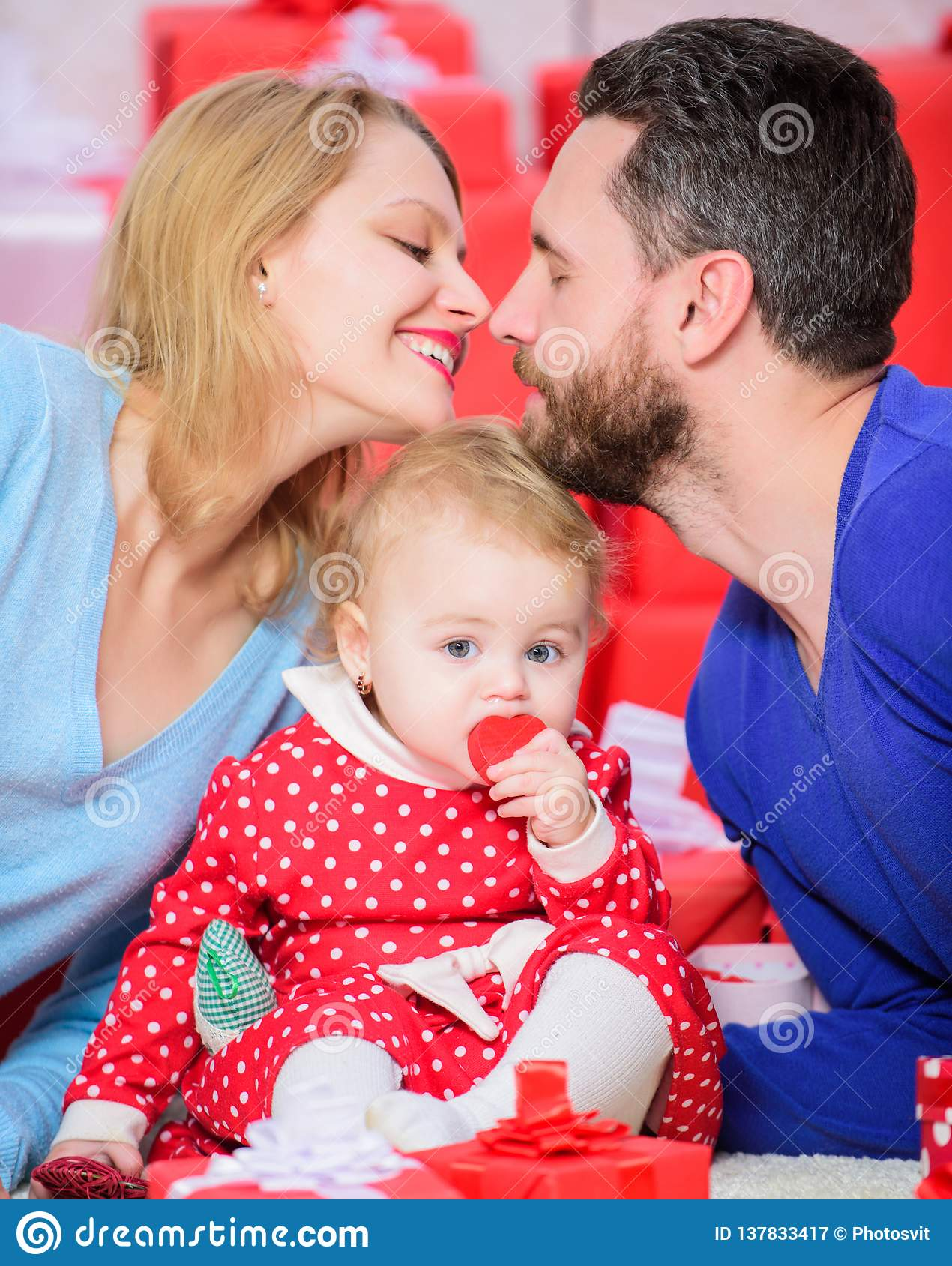 Family celebrate their love romantic couple in love and baby girl valentines day concept