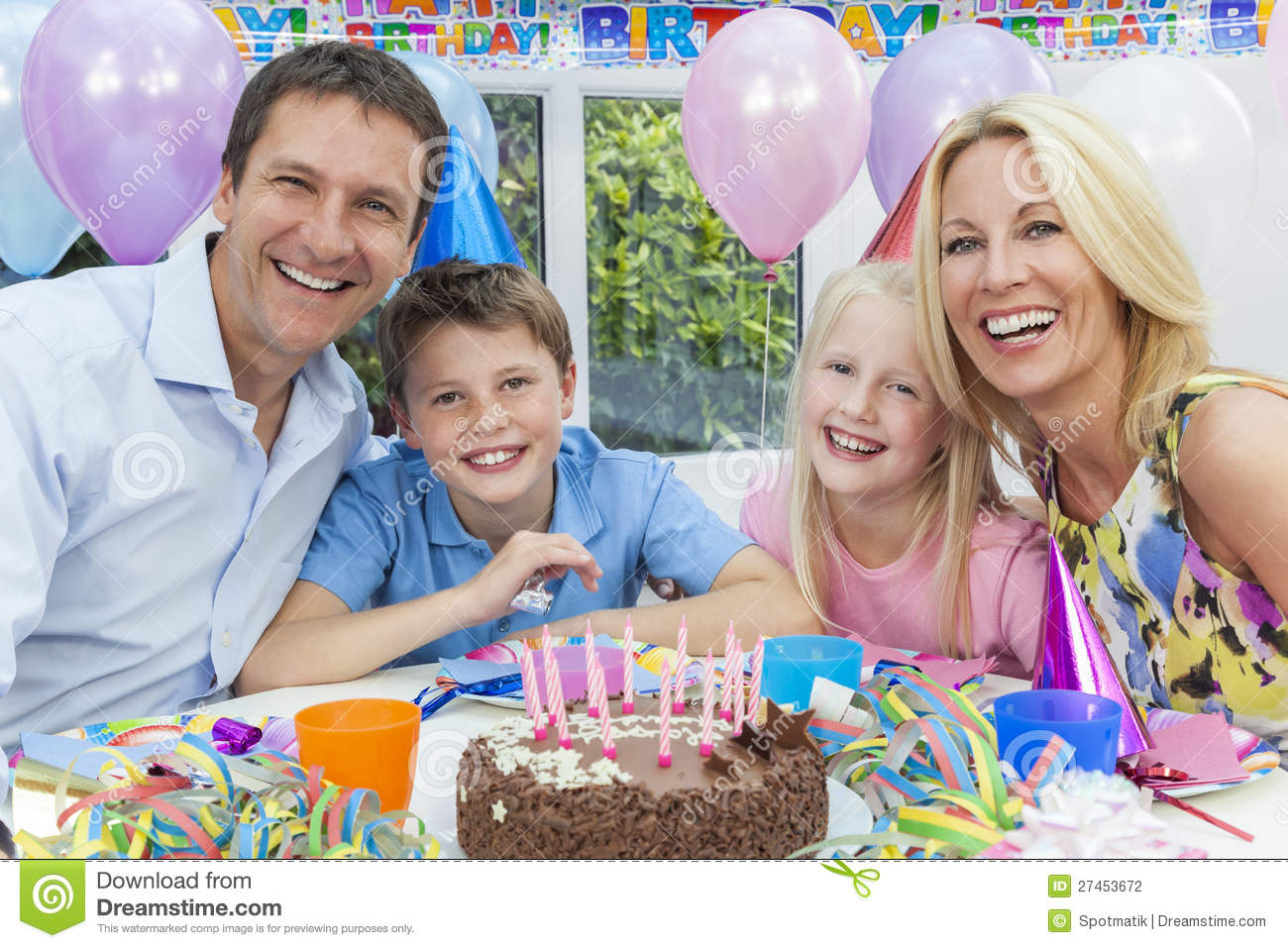 Family Celebrating Children S Birthday Party Cake Stock