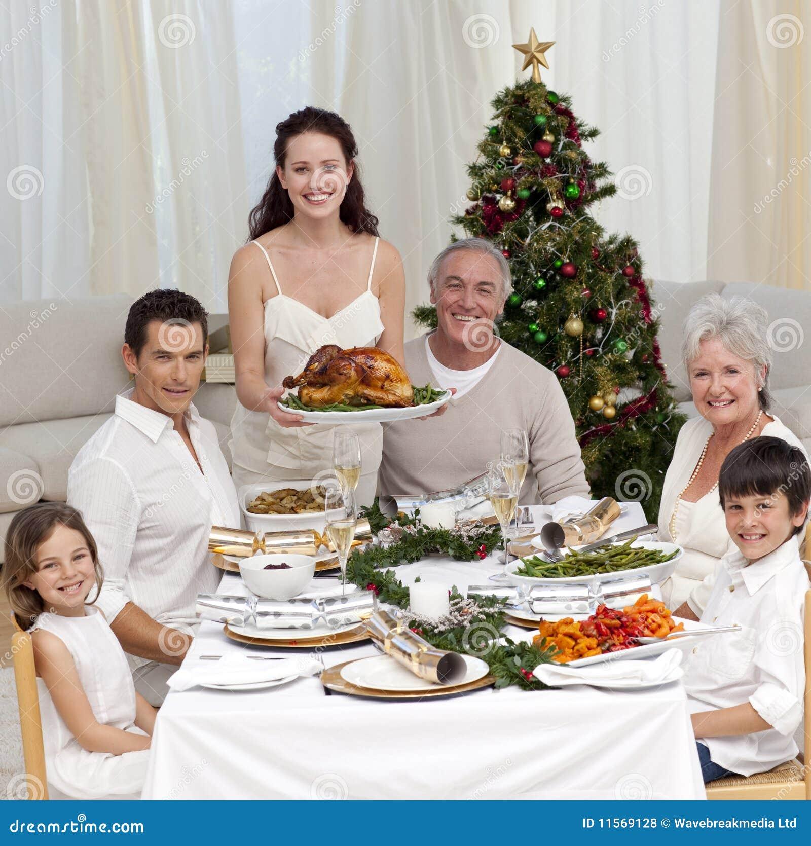 Family Celebrating Christmas Dinner With Turkey Royalty Free Stock Photos