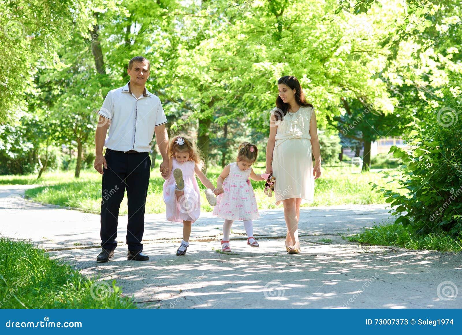 Family Walk In City Park. Stock Photo | CartoonDealer.com ...