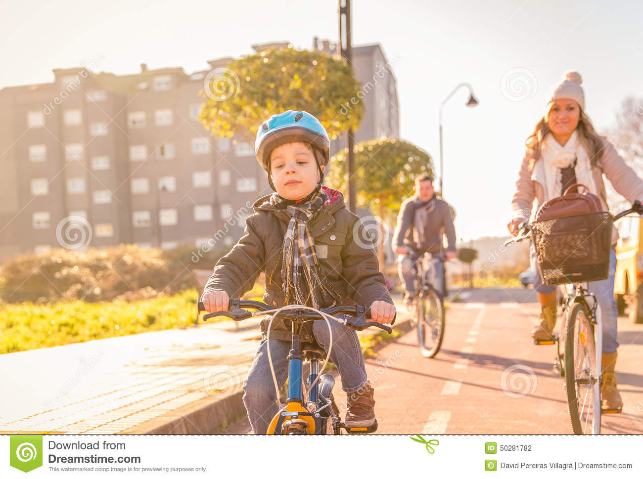 Family with child riding bicycles in the city