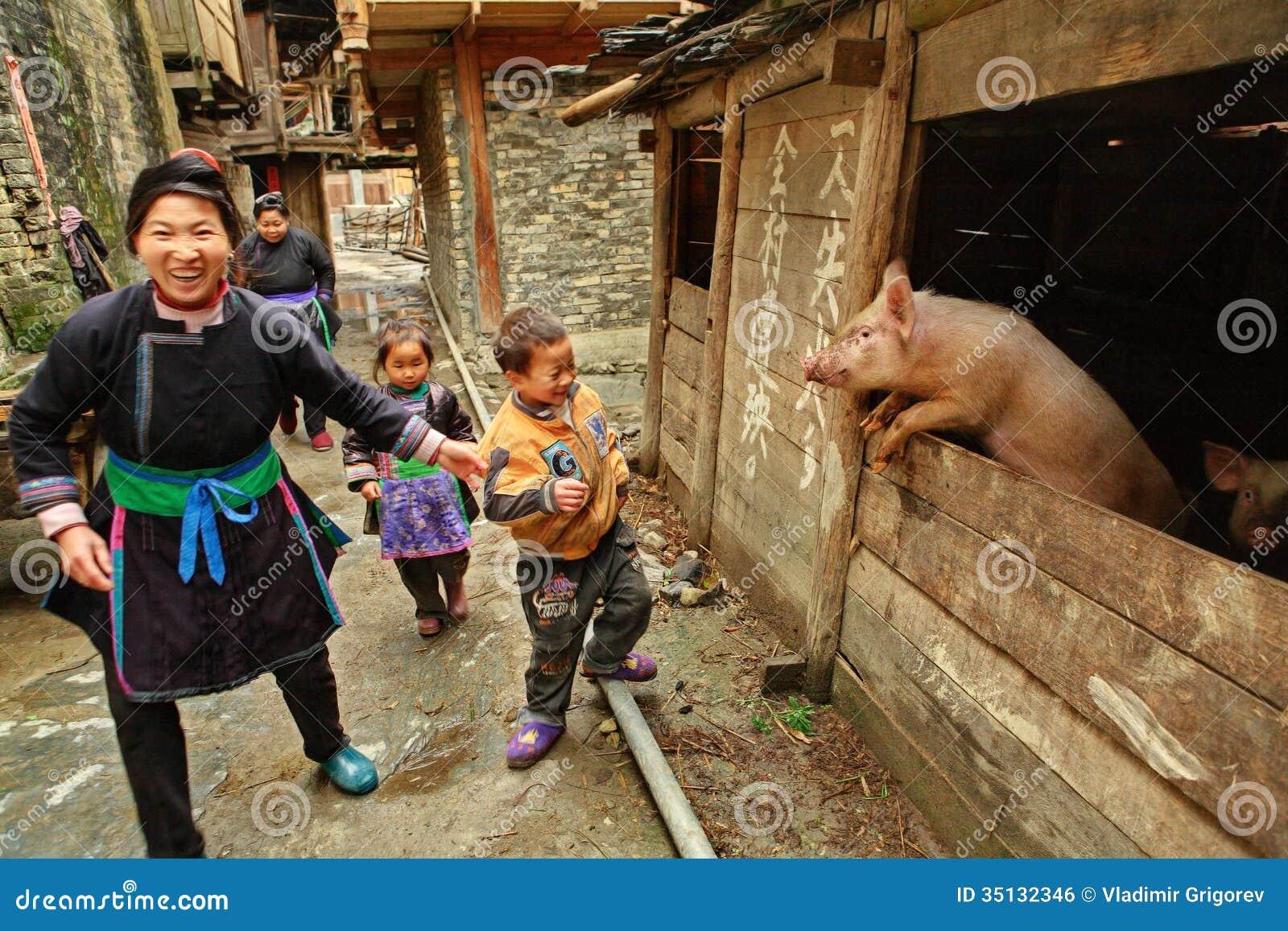 Zengchong village, Guizhou, China - April 13, 2010: The family of ...