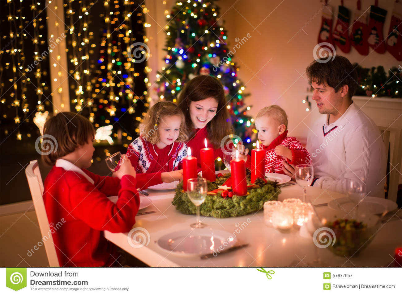 Family With Children At Christmas Dinner Stock Photo - Image: 57677657