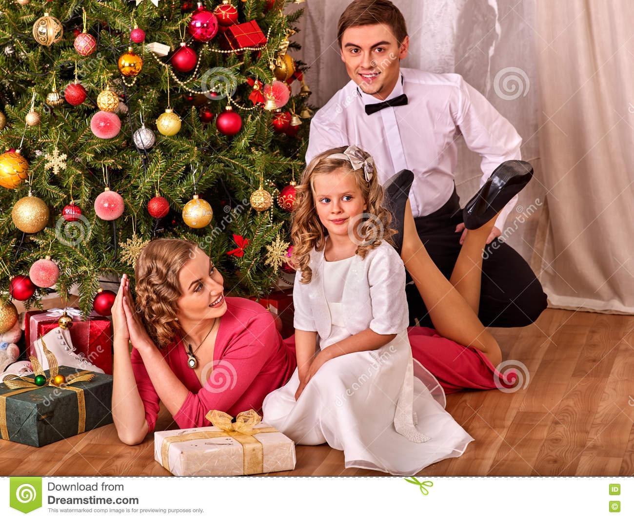 Family With Children Dressing Christmas Tree. Stock Image