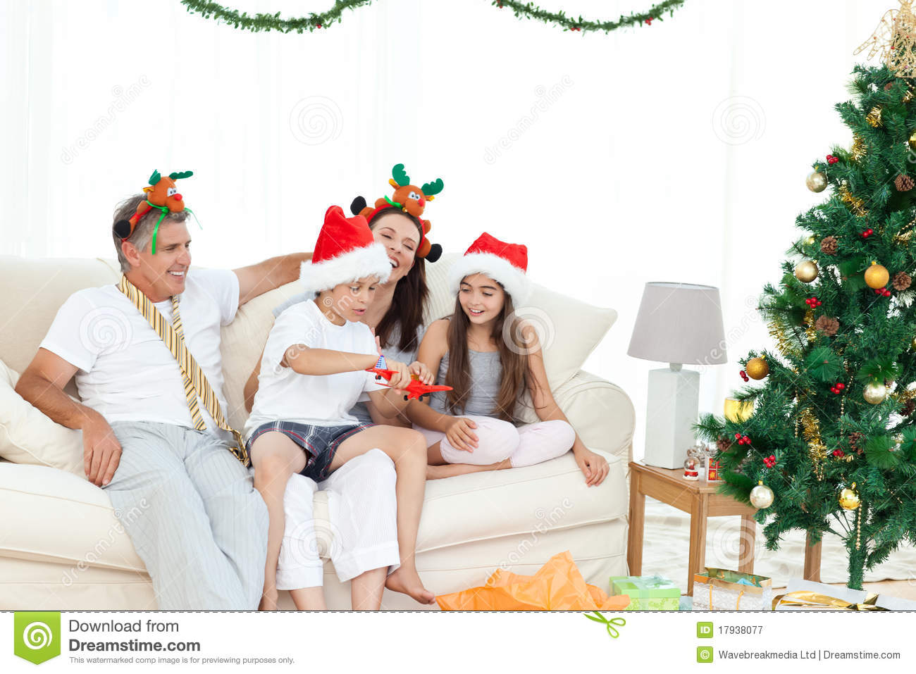 Family During Christmas Day Looking Stock Image - Image of child, event: 17938077