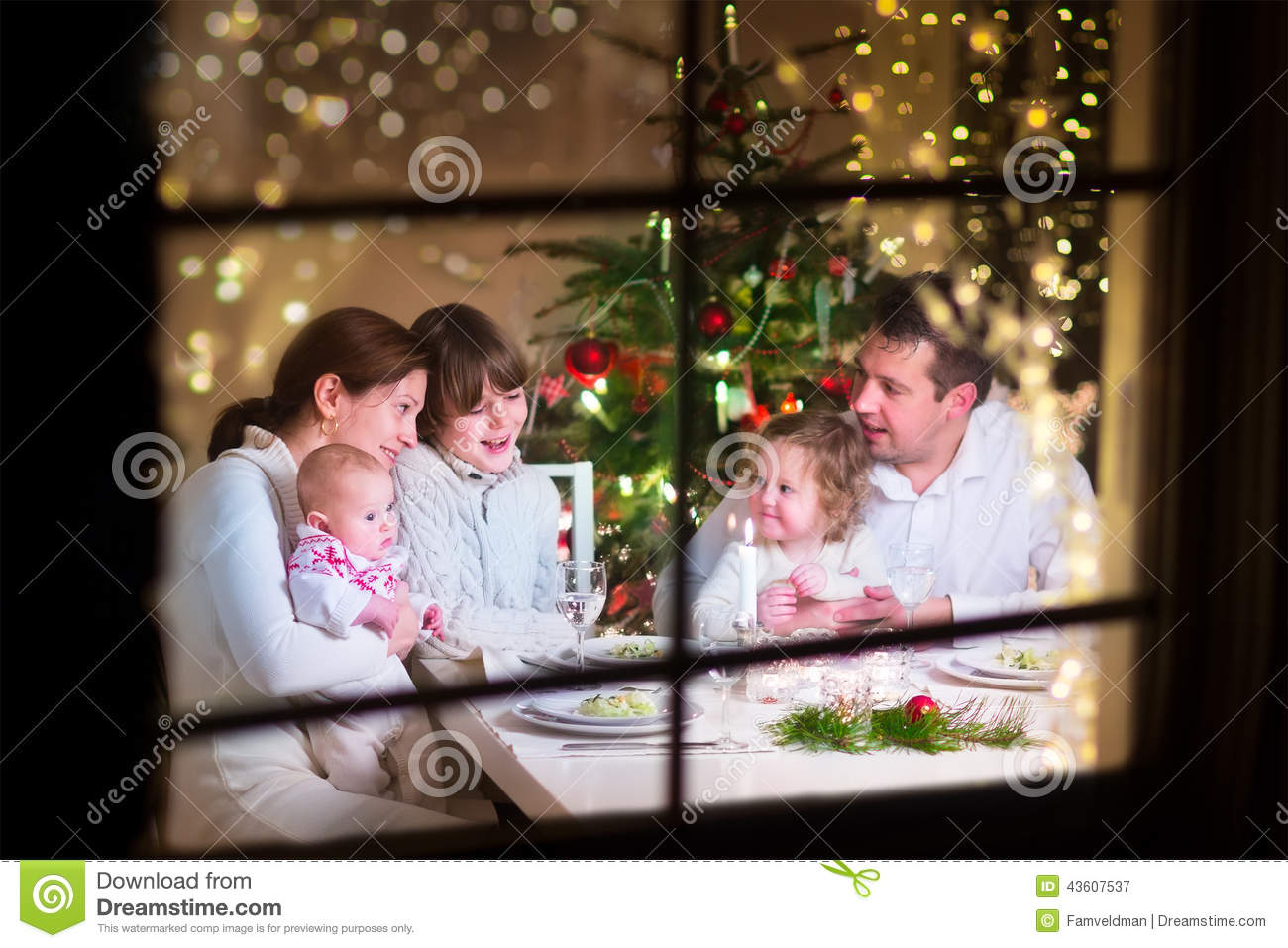 Young big family celebrating Christmas enjoying dinner, view from ...