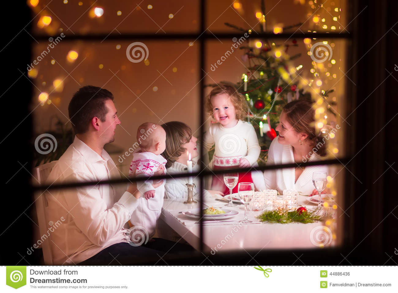 Young big family celebrating christmas enjoying dinner view from
