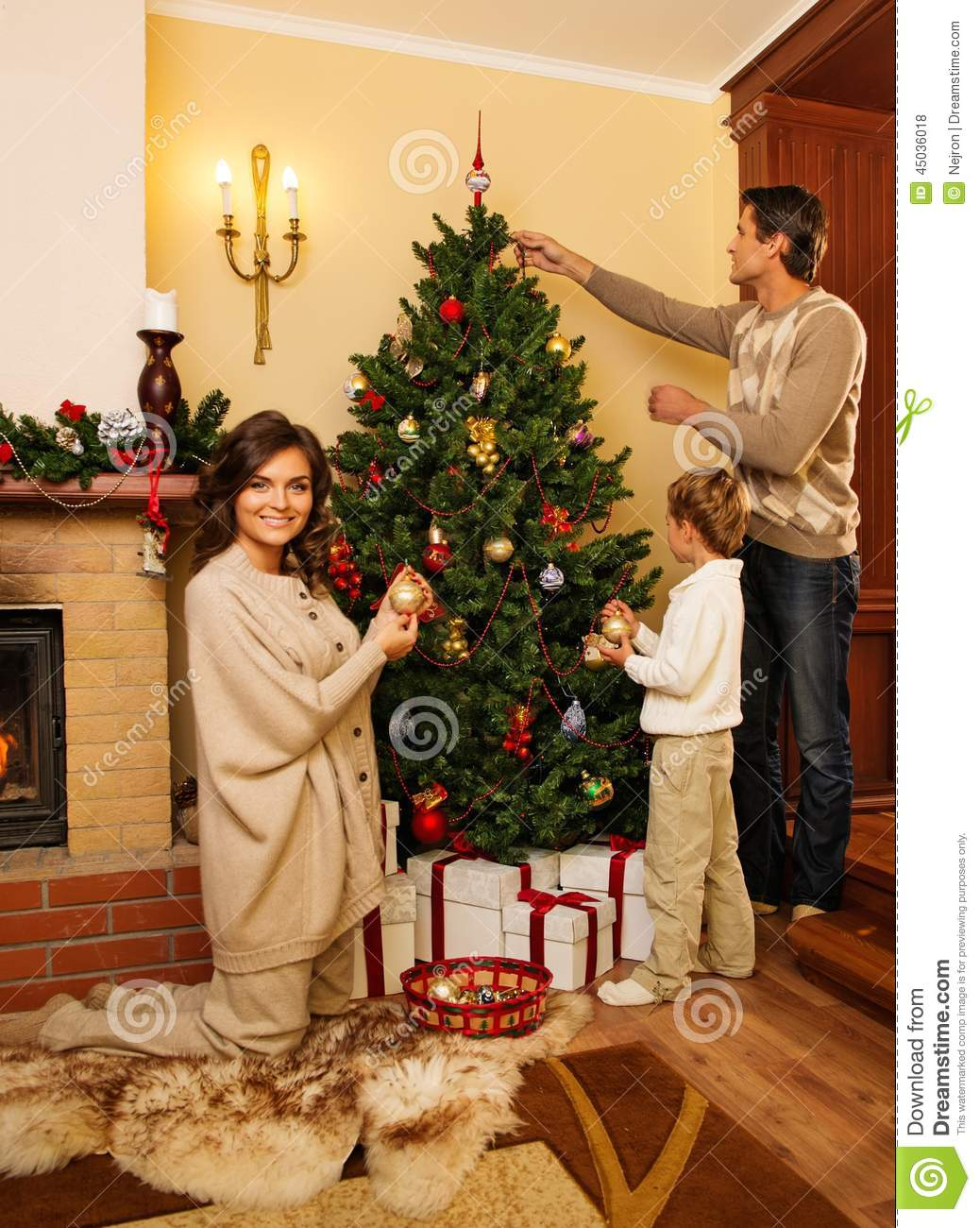 Christmas house interior - Family In Christmas House Interior Stock Photo
