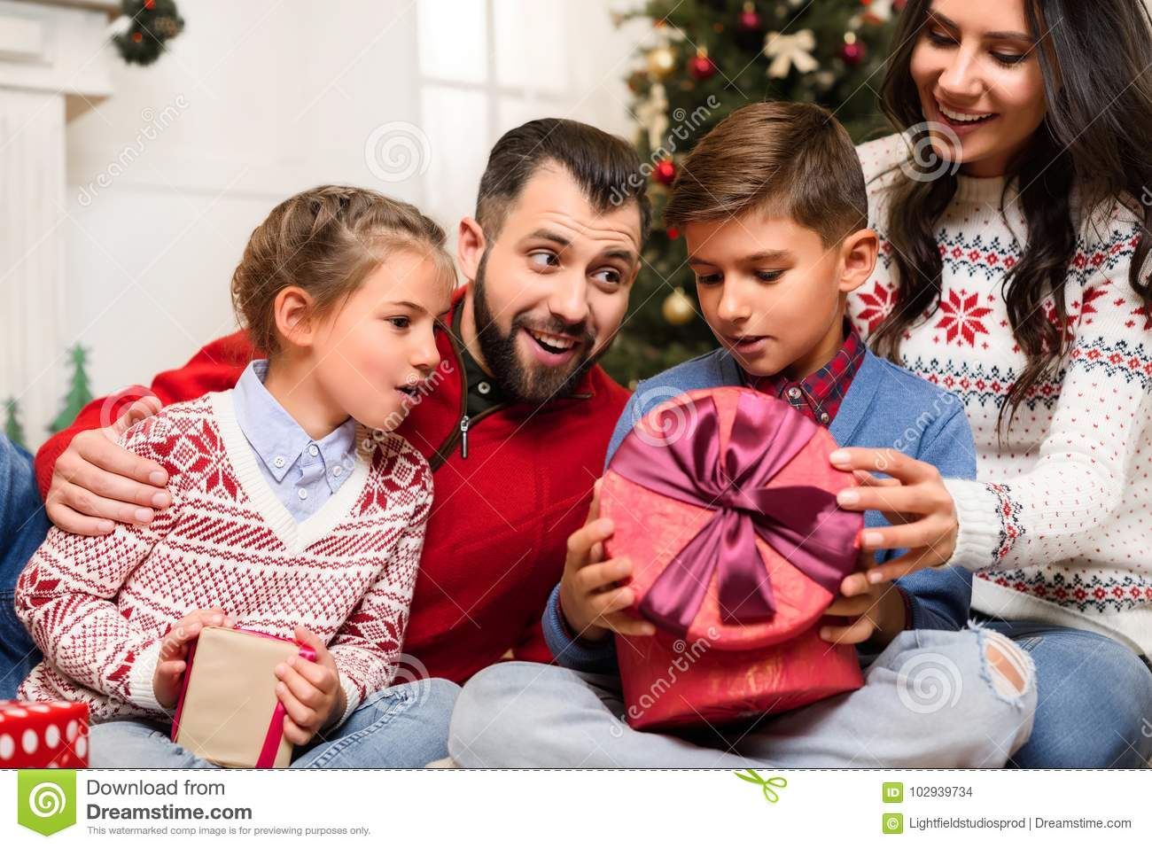 download family with christmas presents stock photo image of traditional holiday 102939734