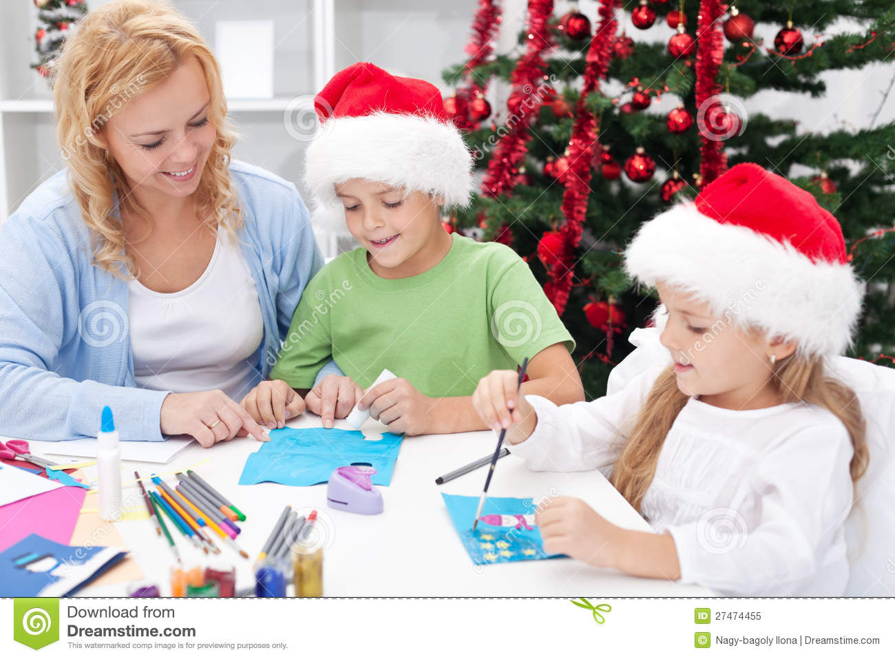 family at christmas time making greeting cards - Family Photo Christmas Cards