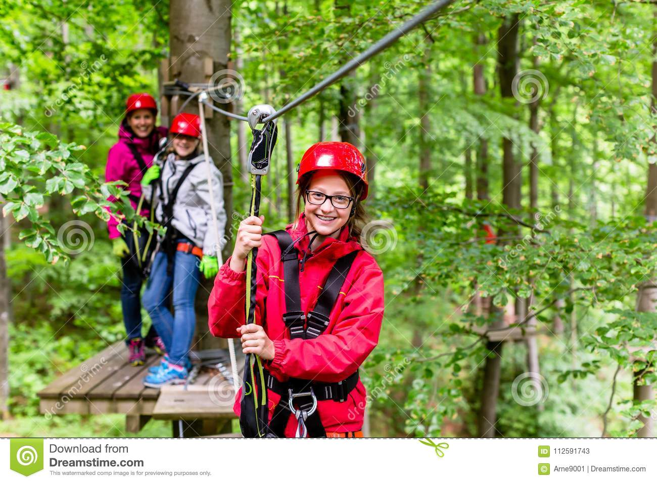 Family climbing in high rope course