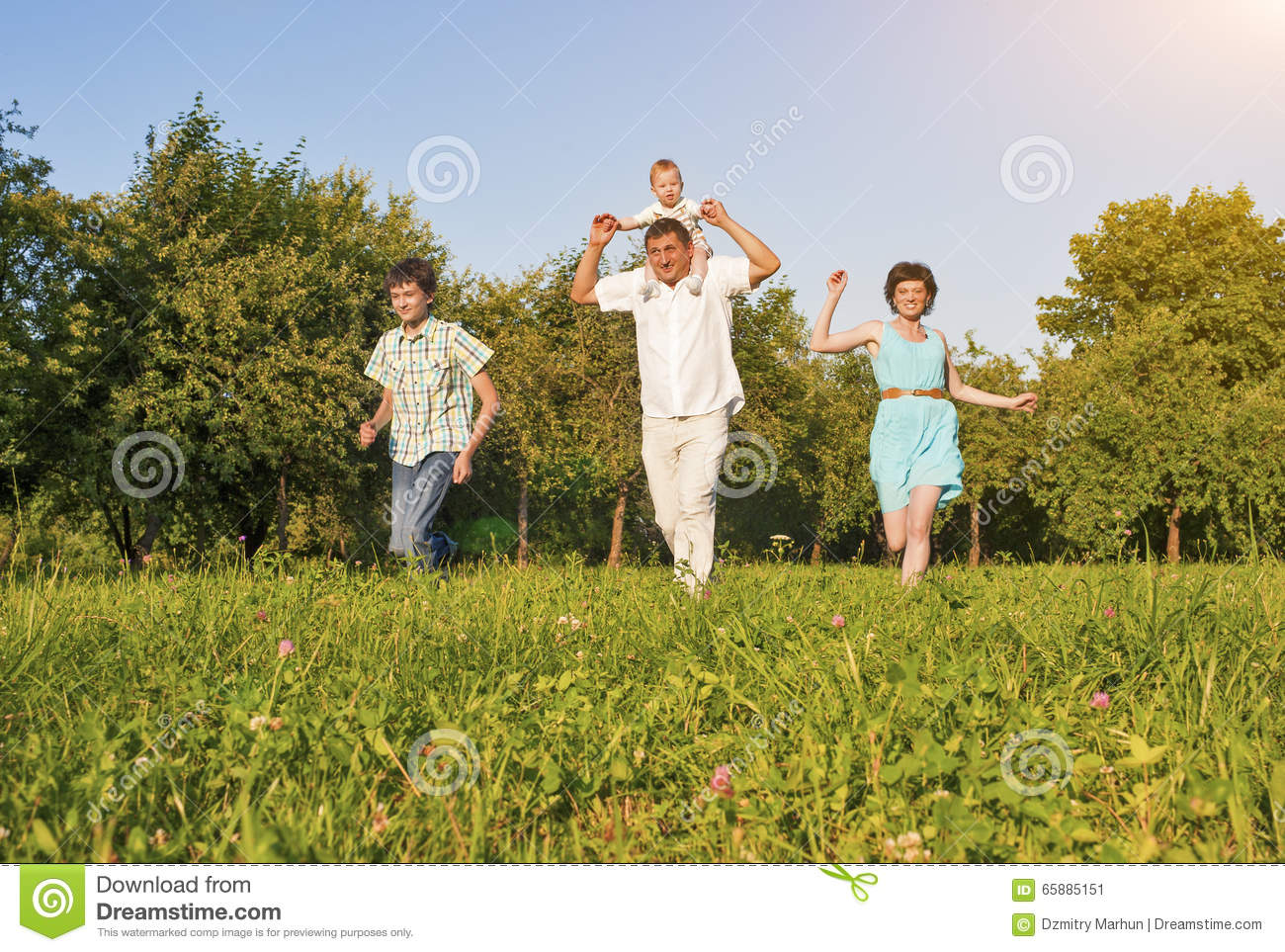 Family Concept And Ideas Happy Of Four Running Together