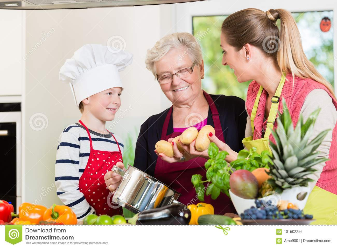 Family cooking in multigenerational household with son, mother,
