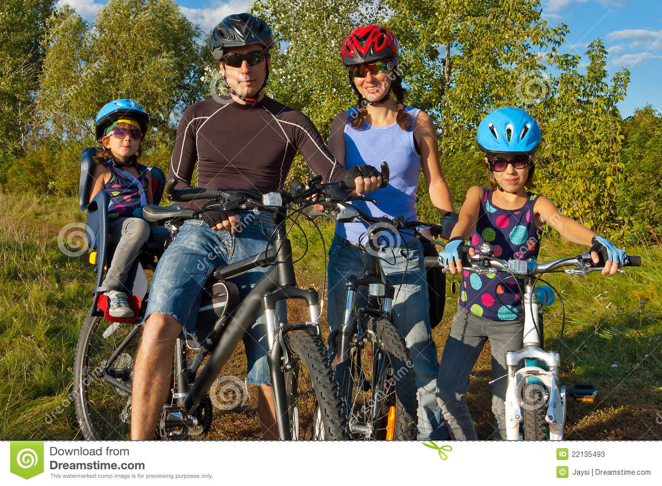 Family Cycling Outdoors. Parents With Kids On Bike Stock